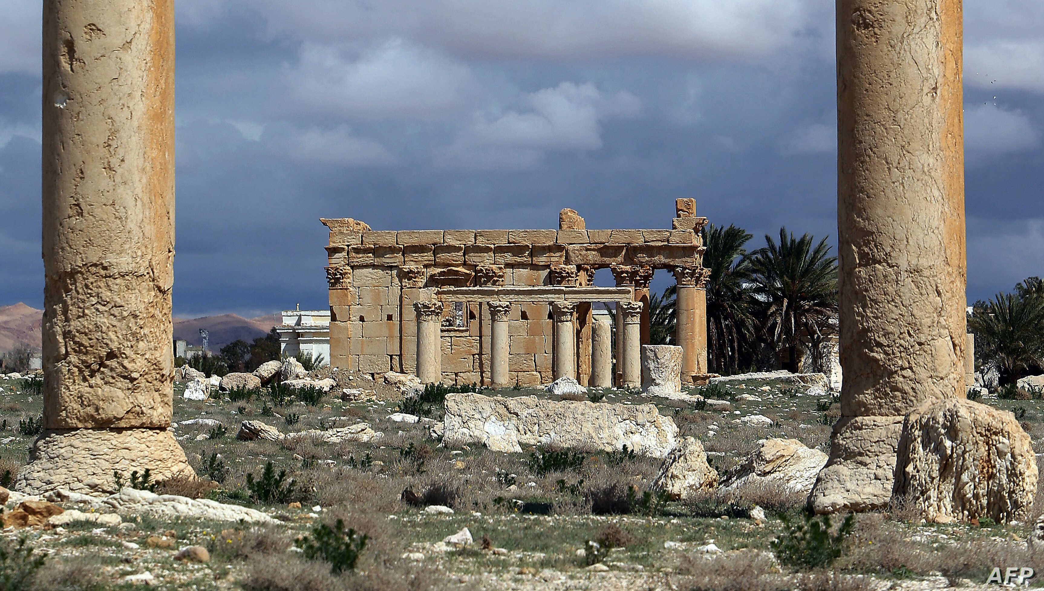 FILE - Temple of Baal Shamin seen through two Corinthian columns in the ancient oasis city of Palmyra, Syria.