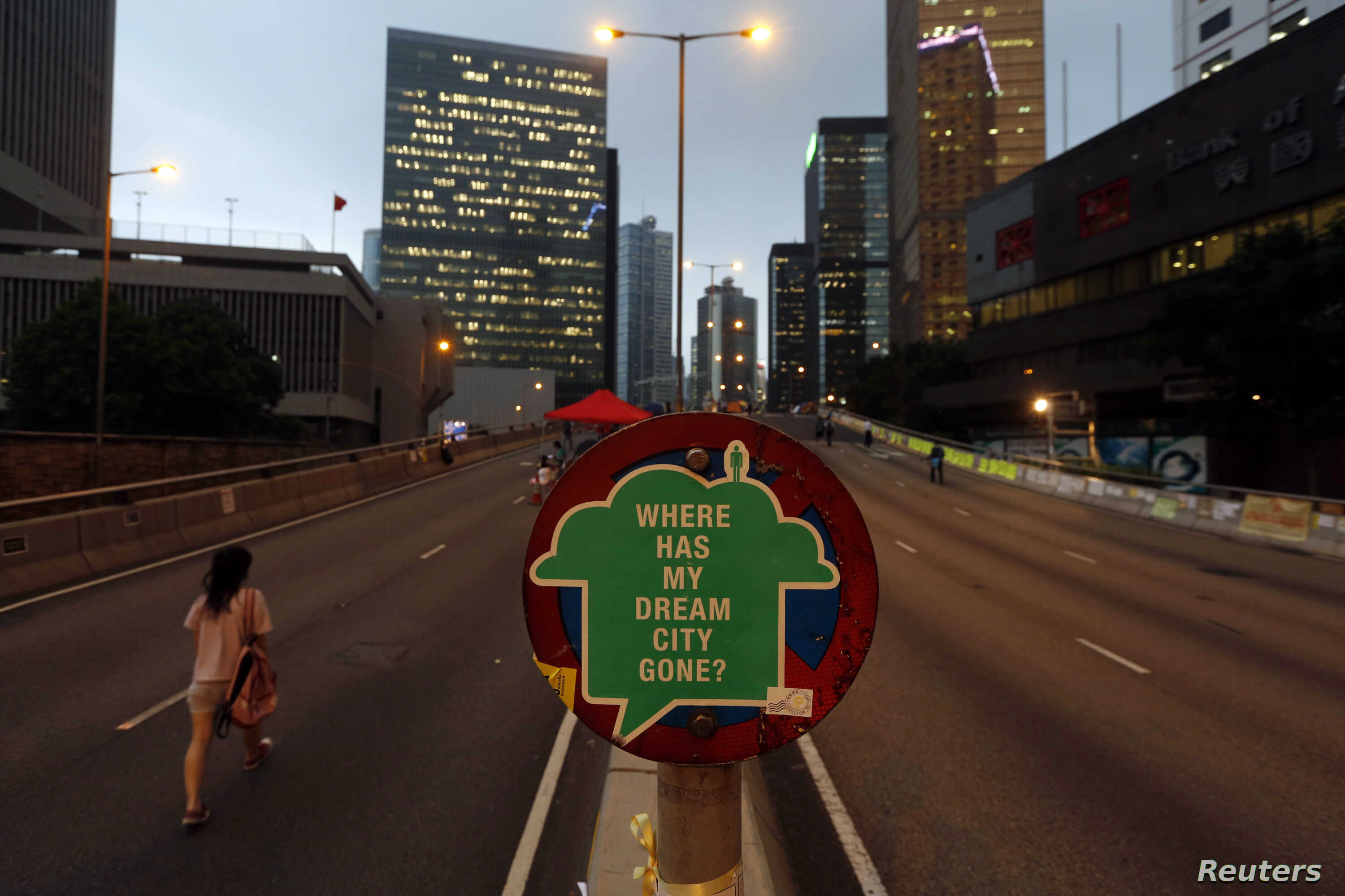 A sign is displayed by pro-democracy protesters on a vehicle bridge in the Central financial district in Hong Kong, Nov. 6, 2014.