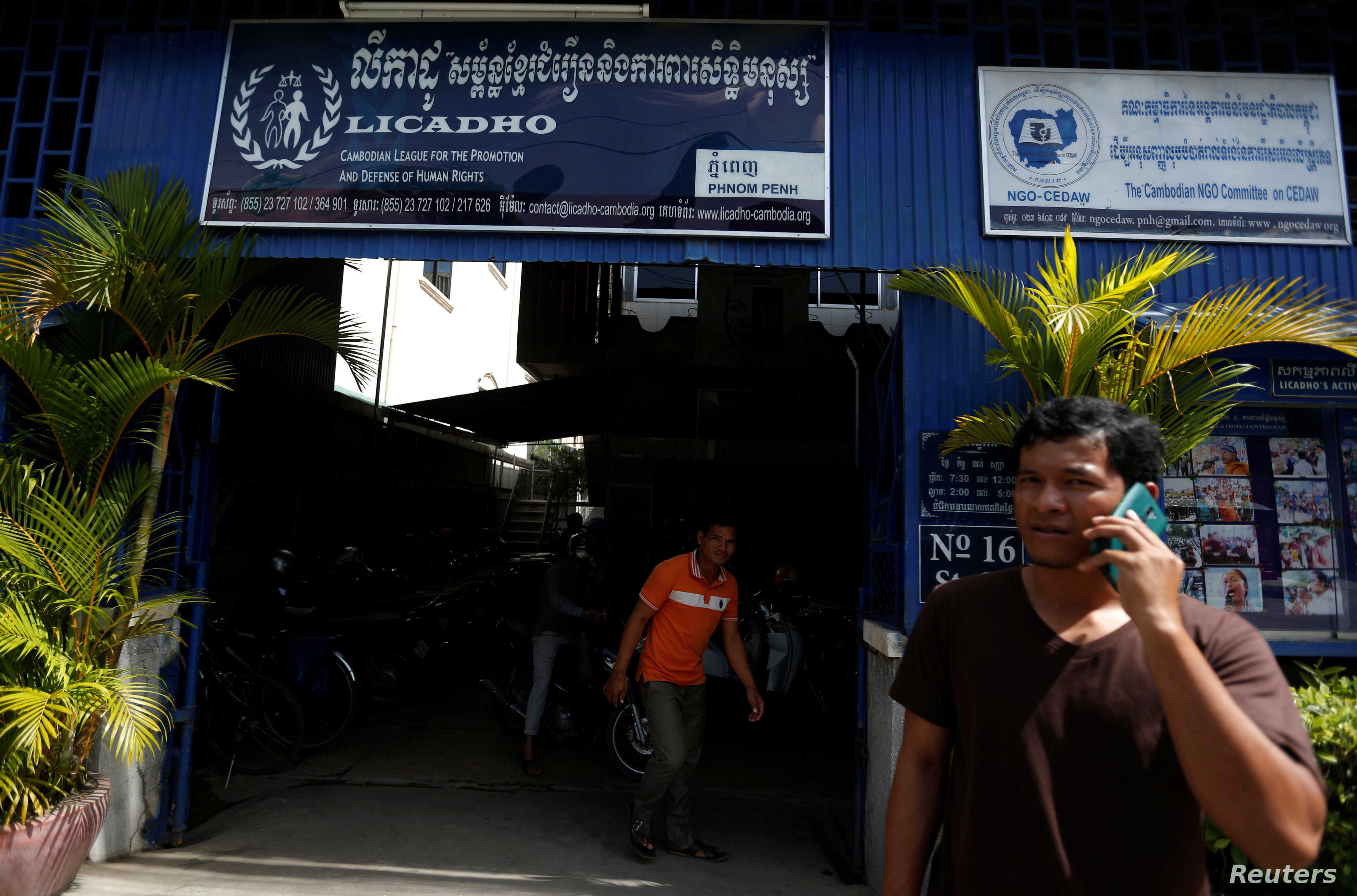 FILE - A man is on the phone in front of the office of the Cambodian League for the Promotion and Defense of Human Rights (LICADHO), in Phnom Penh, Cambodia, Nov. 24, 2017.