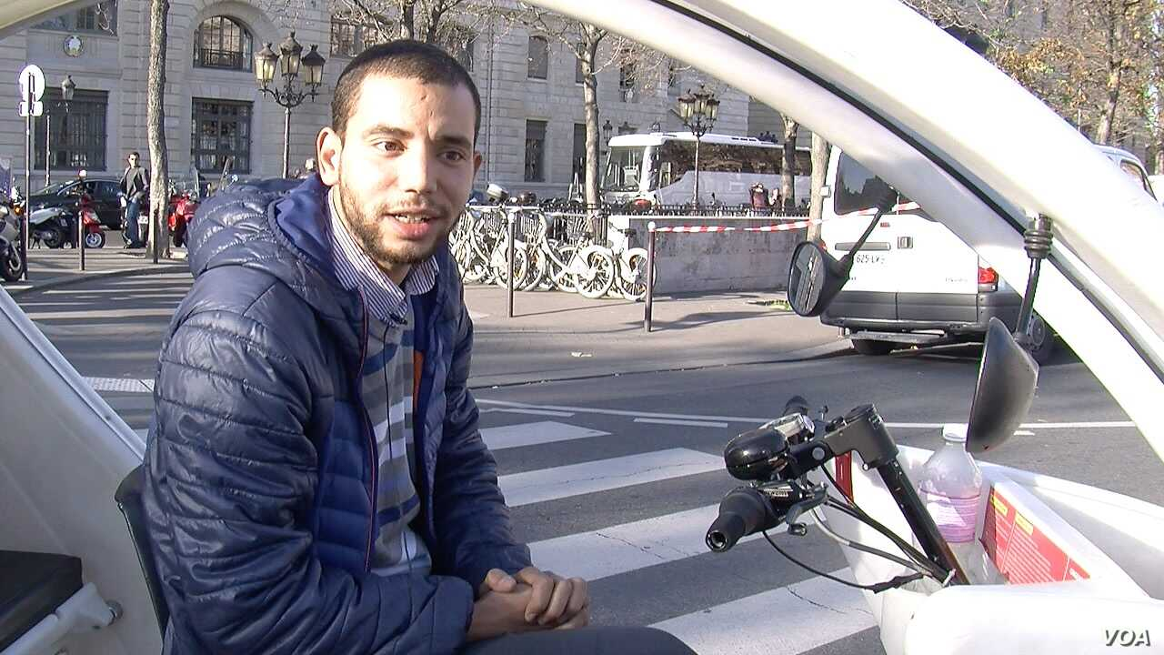 Taxi bike driver Mohamed Nachait expresses concern over terrorism's possible impact on France's tourism industry, in Paris, Nov. 15, 2015. (Photo - L. Bryant/VOA)