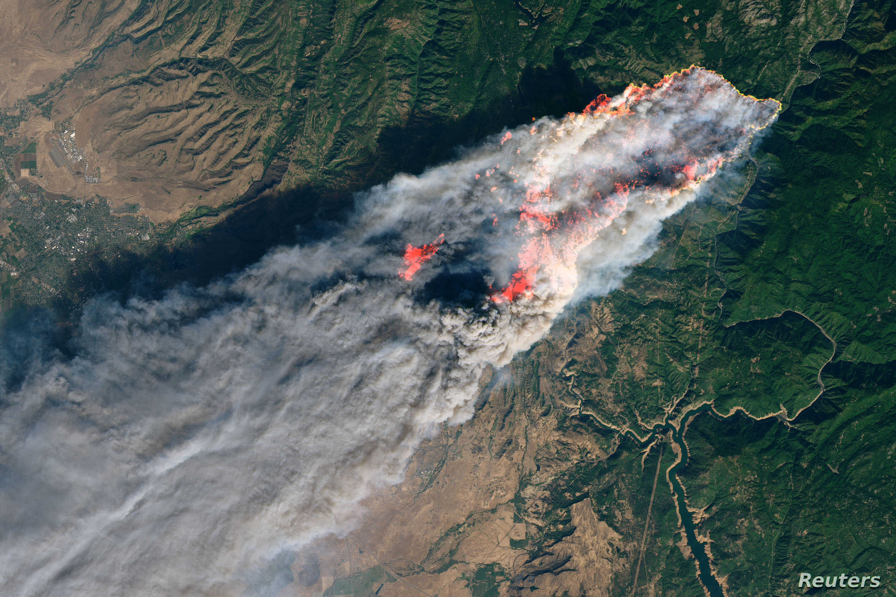 FILE - NASA's Operational Land Imager satellite image shows the Camp Fire burning at around 10:45 a.m. local time near Paradise, California, U.S., on Nov. 8, 2018.
