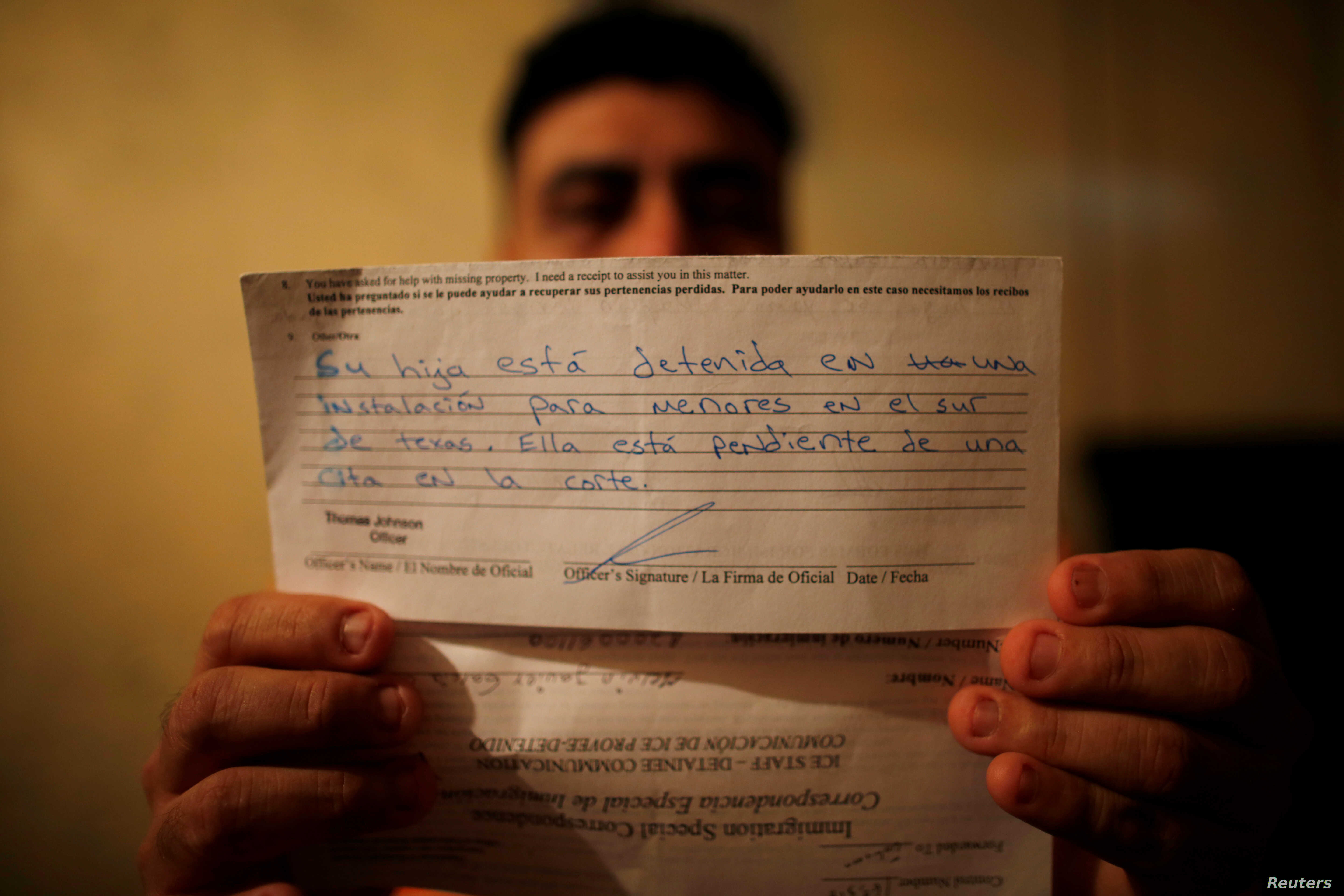 Melvin Garcia, 37, a deportee from the U.S. who was separated from his daughter Daylin Garcia, 12, at the McAllen entry point under the Trump administration's hardline immigration policy, shows a letter sent by U.S. Immigration and Customs Enforcemen...
