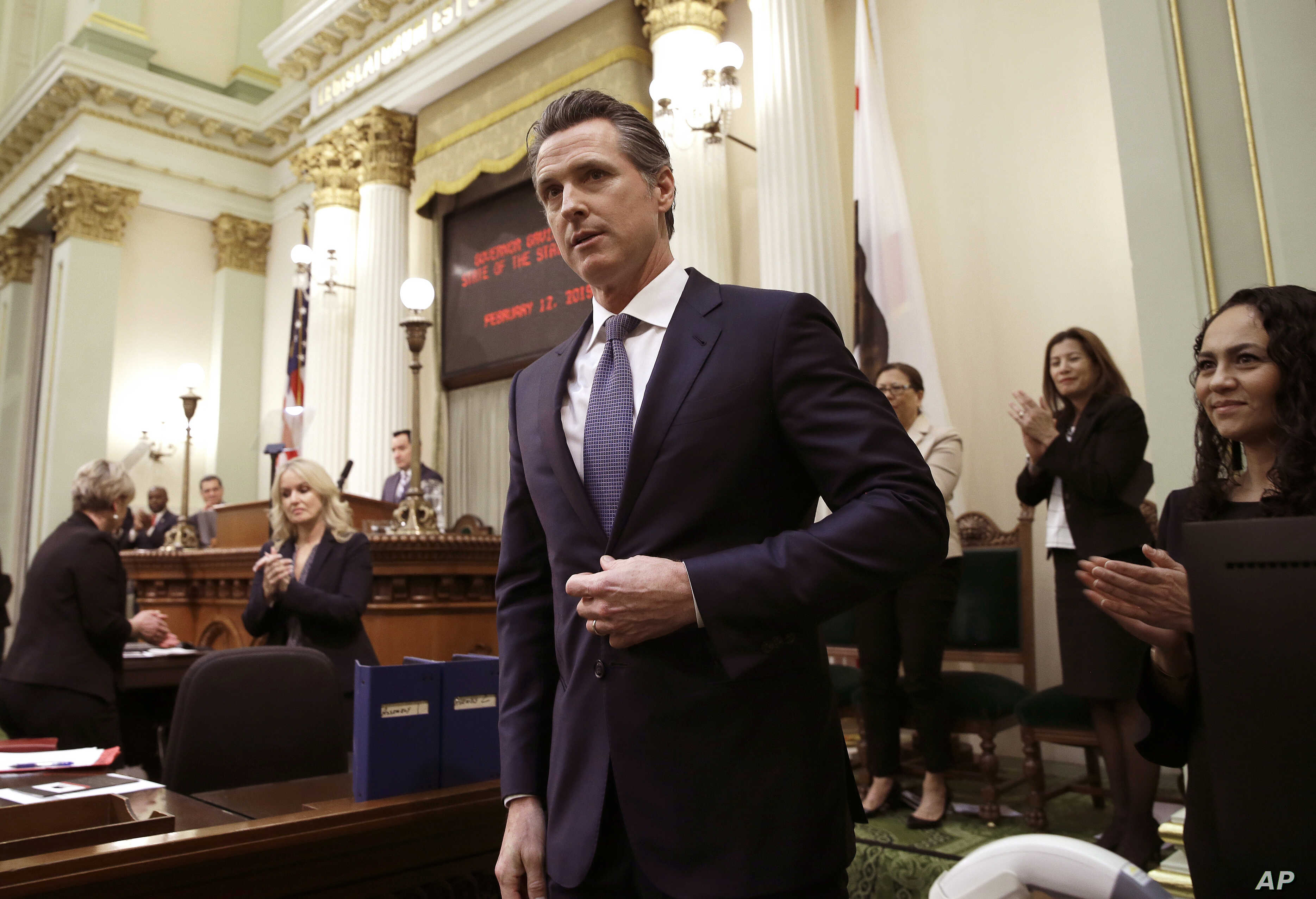 FILE - California Gov. Gavin Newsom receives applause after delivering his first state of the state address to a joint session of the legislature at the Capitol in Sacramento, Calif., Feb. 12, 2019.