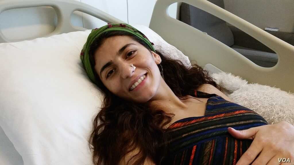 1-Lisa Calan receiving treatment in Diyarbakir hospital after she lost her legs from an explosion in June 5, 2015., Diyarbakir, Turkey.