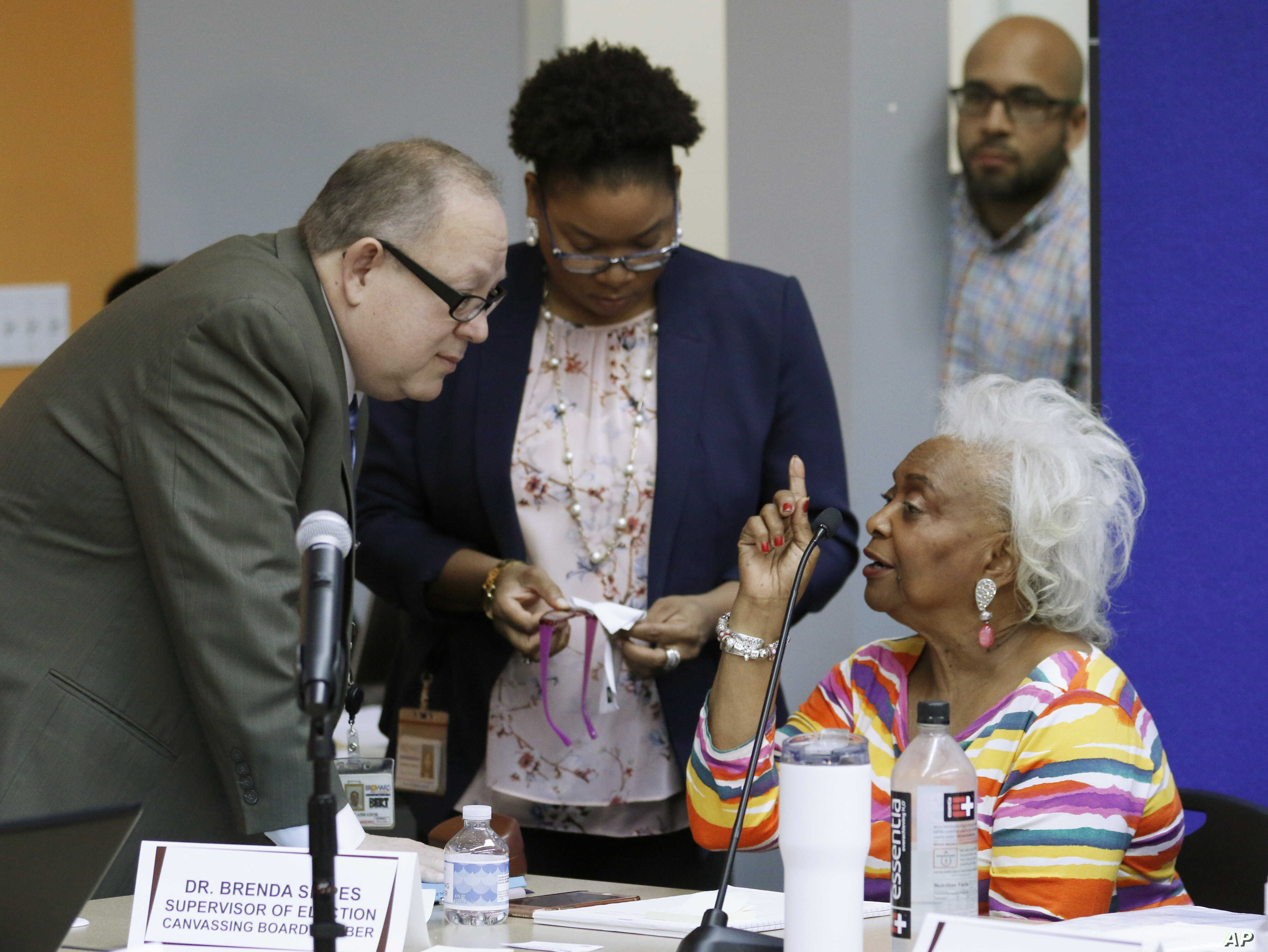 Brenda Snipes, Broward County supervisor of elections, right, speaks with officials before a canvassing board meeting Nov. 9, 2018, in Lauderhill, Fla. Florida  will learn Saturday afternoon whether there will be recounts in the U.S. Senate race betw...