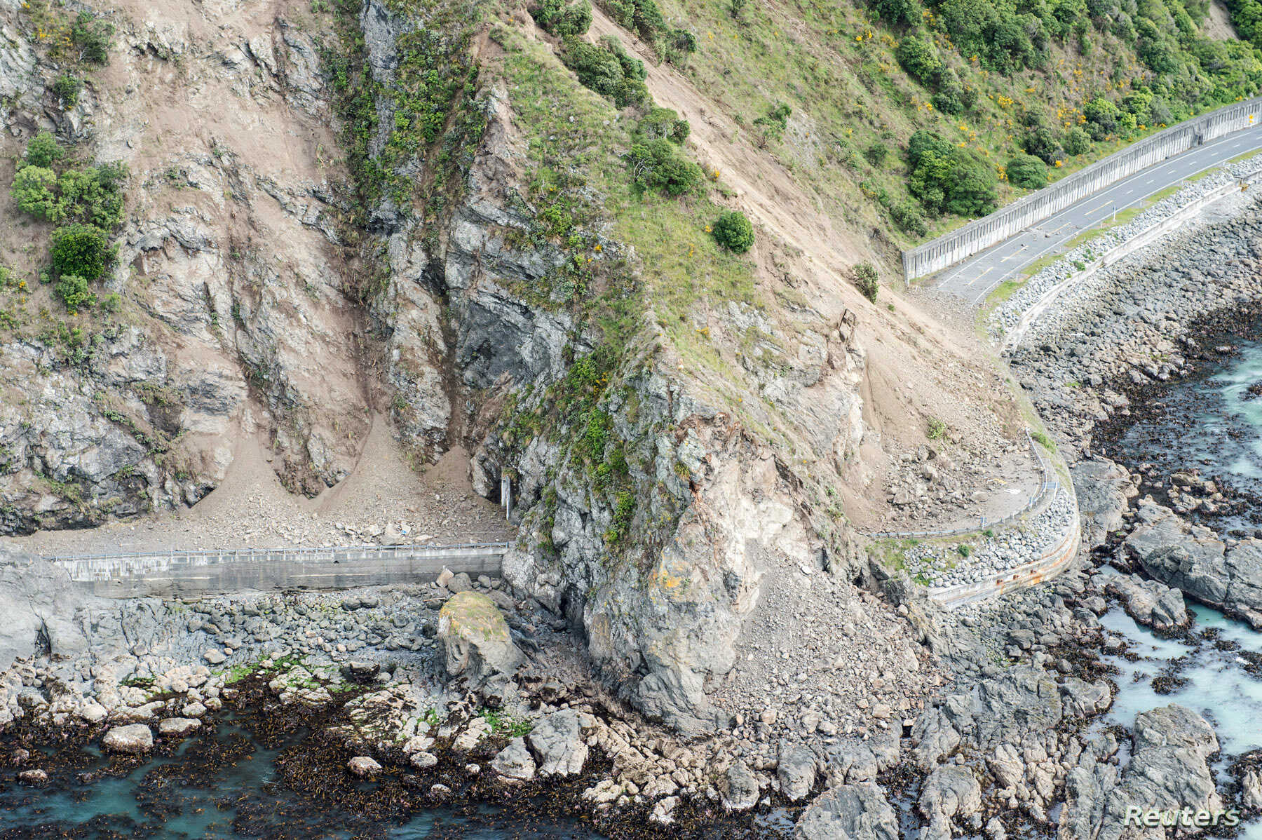 Landslides block State Highway One near Kaikoura on the upper east coast of New Zealand's South Island following an earthquake, Nov. 14, 2016.