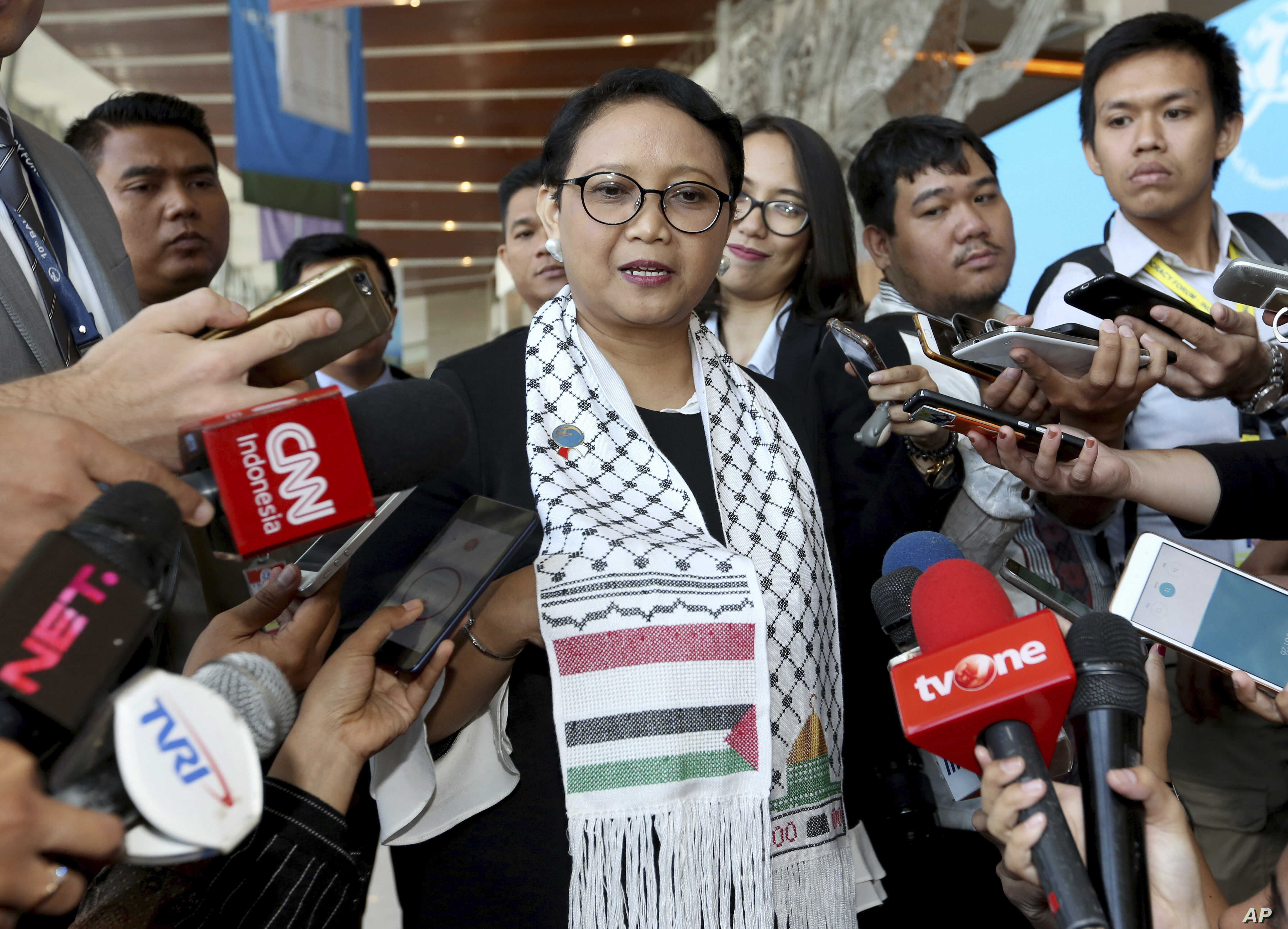 Wearing a Palestinian scarf, Indonesian Foreign Minister Retno Marsudi, center, talks to the media during Bali Democracy Forum held in Tangerang on the outskirts of Jakarta, Indonesia, Thursday, Dec. 7, 2017. Marsudi condemned the U.S. recognition of...
