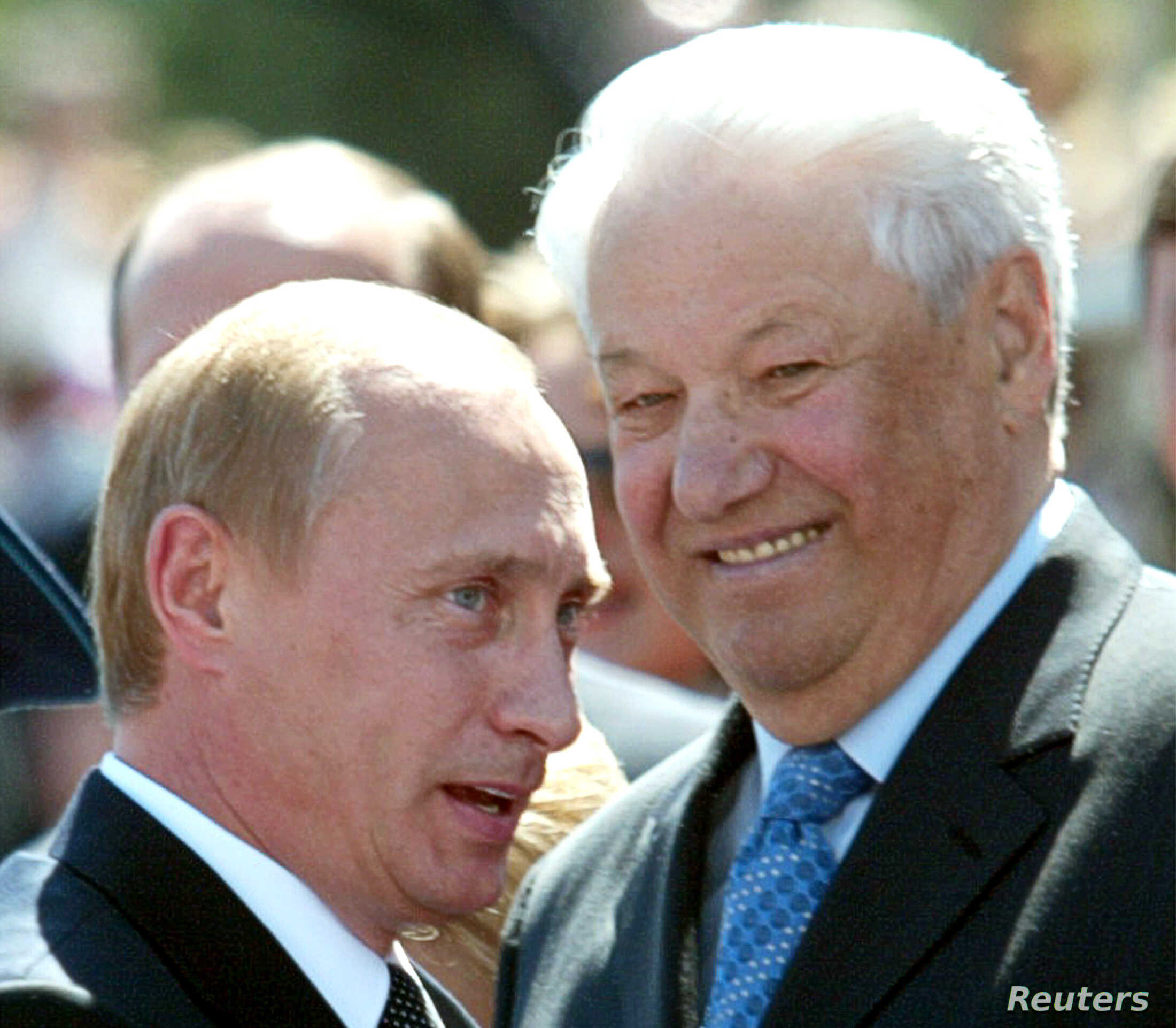 """Russian President Vladimir Putin speaks as former Russian president Boris Yeltsin (R) smiles during festivities in Red Square in Moscow, June 12, 2004. The holiday, mostly commonly known among Russians as """"Independence Day"""", marks the adoption by the..."""