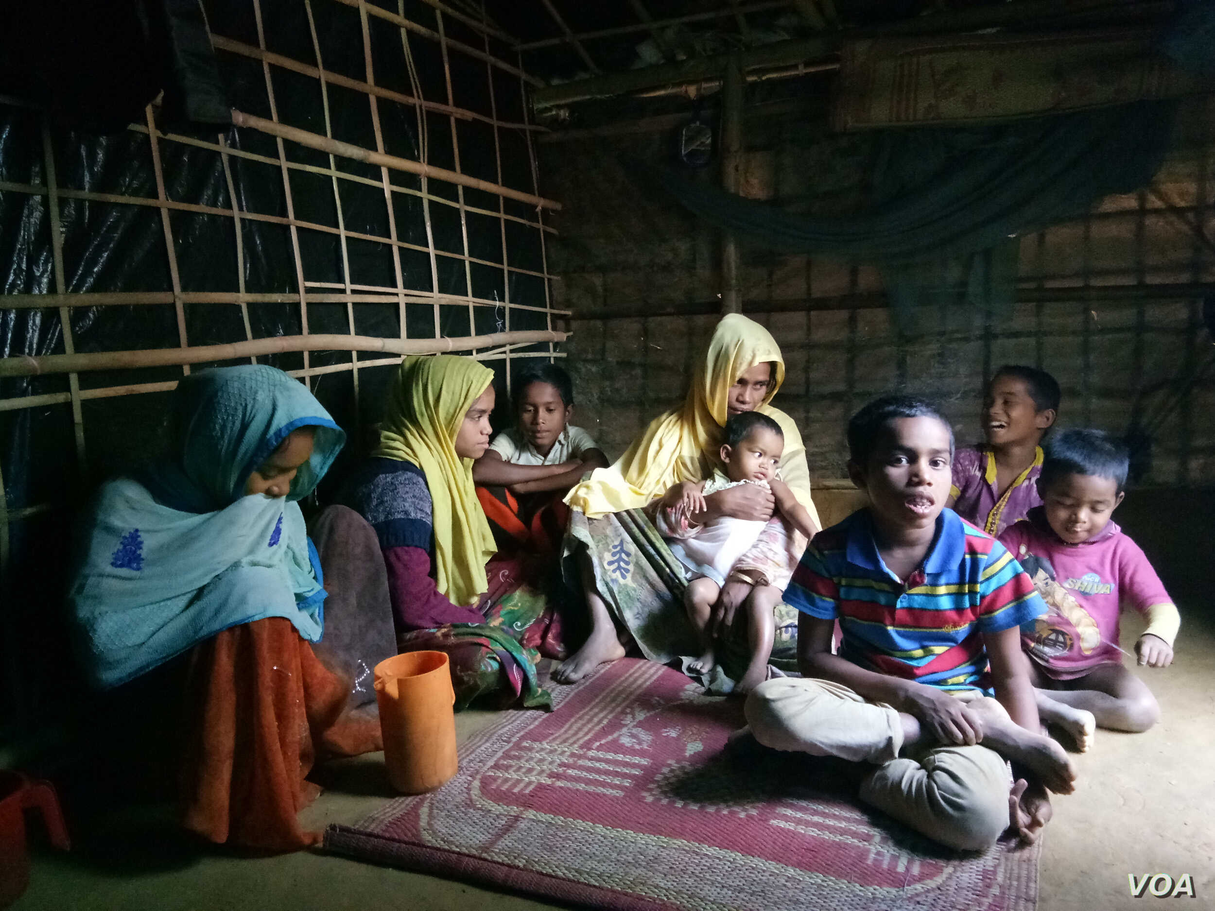 """Rohingya refugee Samsun Nahar, a widow with nine children, is searching for """"two good boys"""" to marry her 14 and 13-year old daughters as soon as possible. (Photos by Noor Hossain)"""