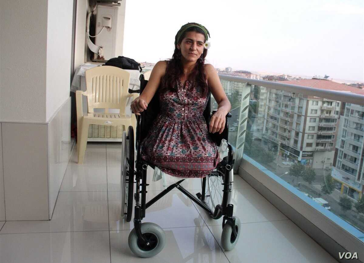 Lisa Calan on her wheelchair while being interviewed by Turkish reporters at her home five months after the Diyarbakir bombing that cost her two legs, Diyarbakir, Turkey, Oct. 2015.