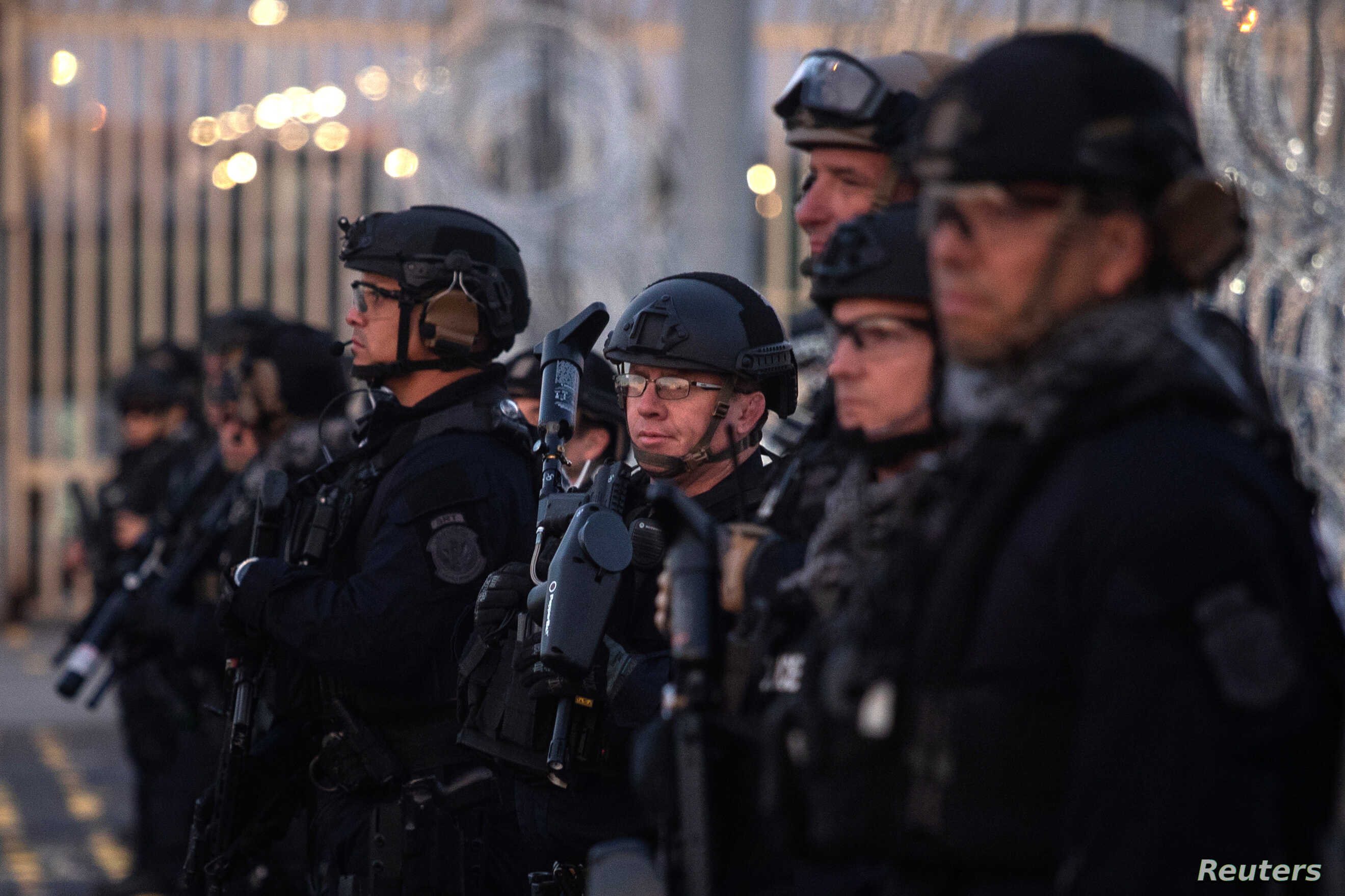 U.S. Customs and Border Protection (CBP) Special Response Team (SRT) officers stand guard at the San Ysidro Port of Entry after the land border crossing was temporarily closed to traffic from Tijuana, Mexico, Nov. 19, 2018.