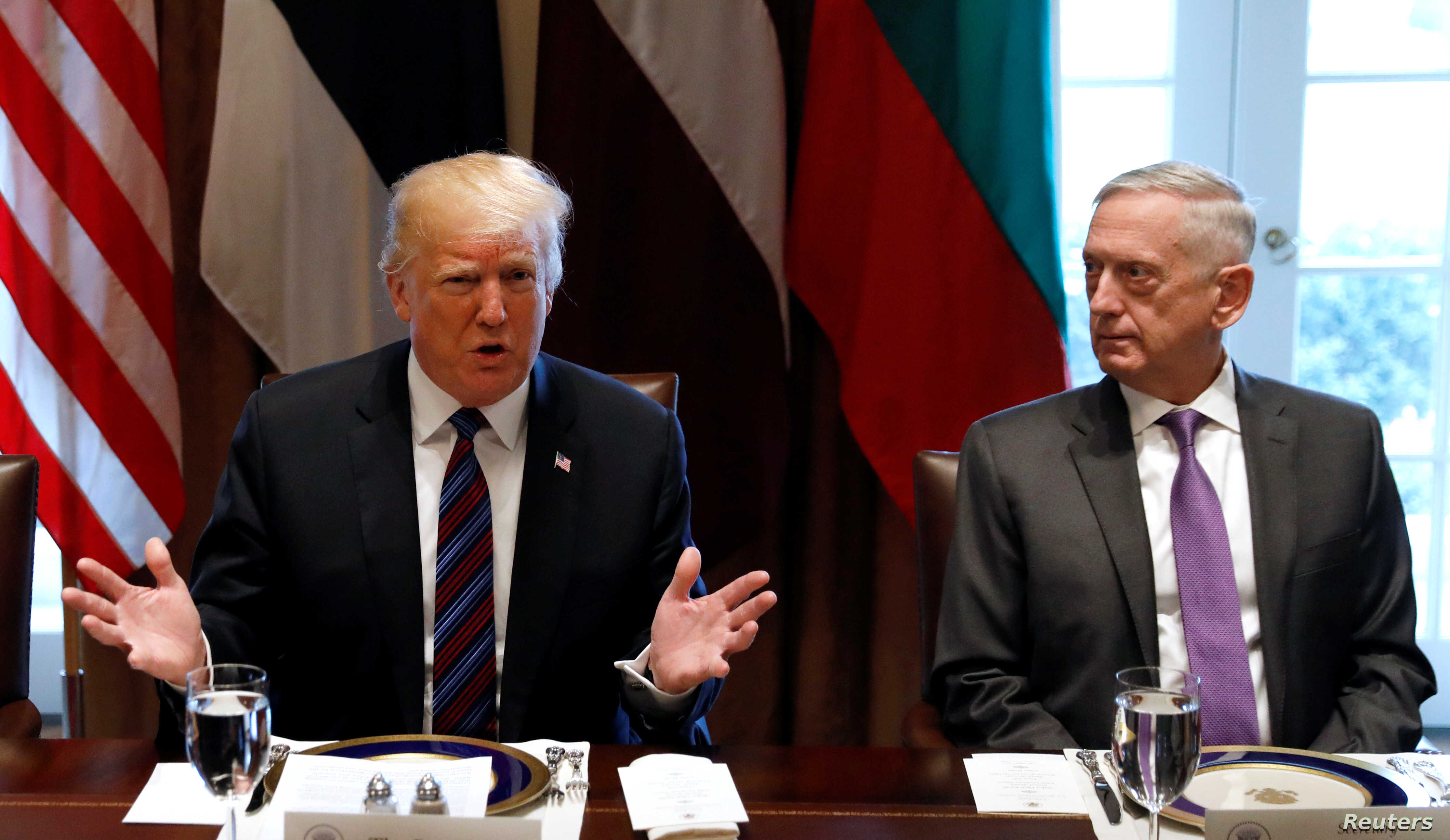 FILE - With U.S. Secretary of Defense James Mattis at his side, U.S. President Donald Trump speaks during a meeting at the White House in Washington, April 3, 2018.