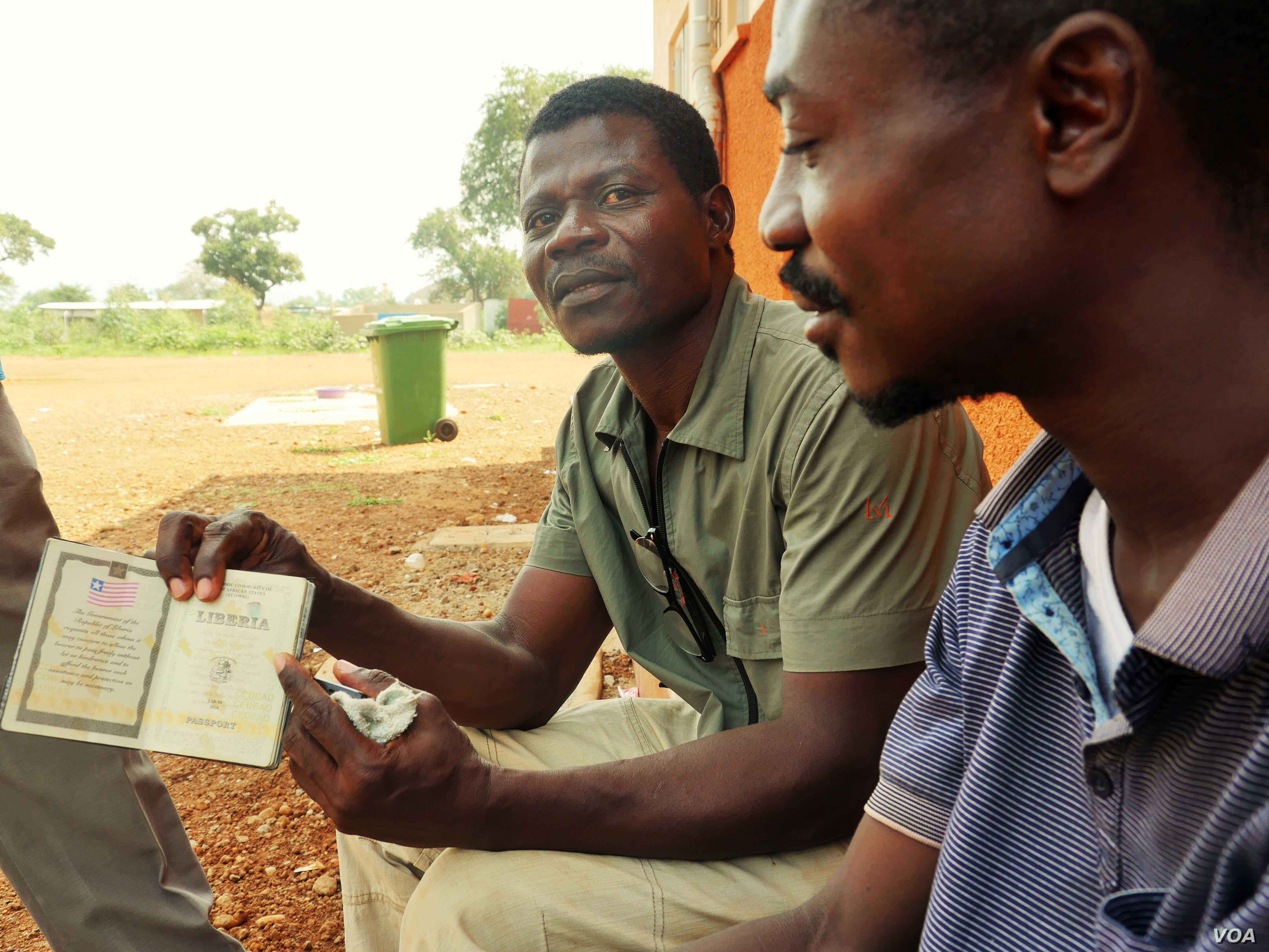 Edwin Taylor and his brother Samson Carl Lewis are two Liberians who were working in South Sudan. They say on their journey south to Uganda they saw bodies and burnt out cars. (L. Paulat/VOA)