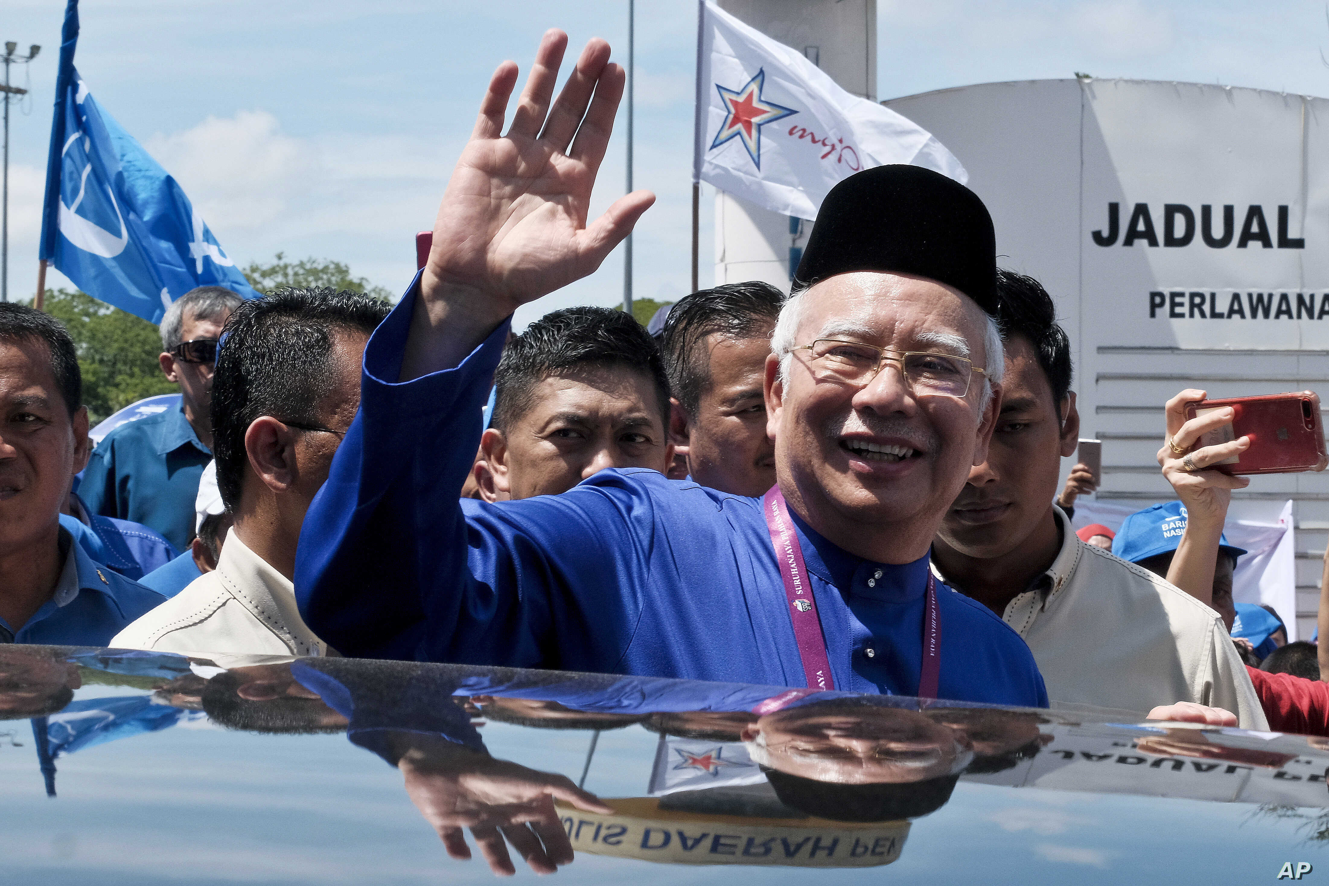 Malaysian Prime Minister Najib Razak waves to his supporters after his election nomination in Pekan, Pahang state, Malaysia, April 28, 2018.
