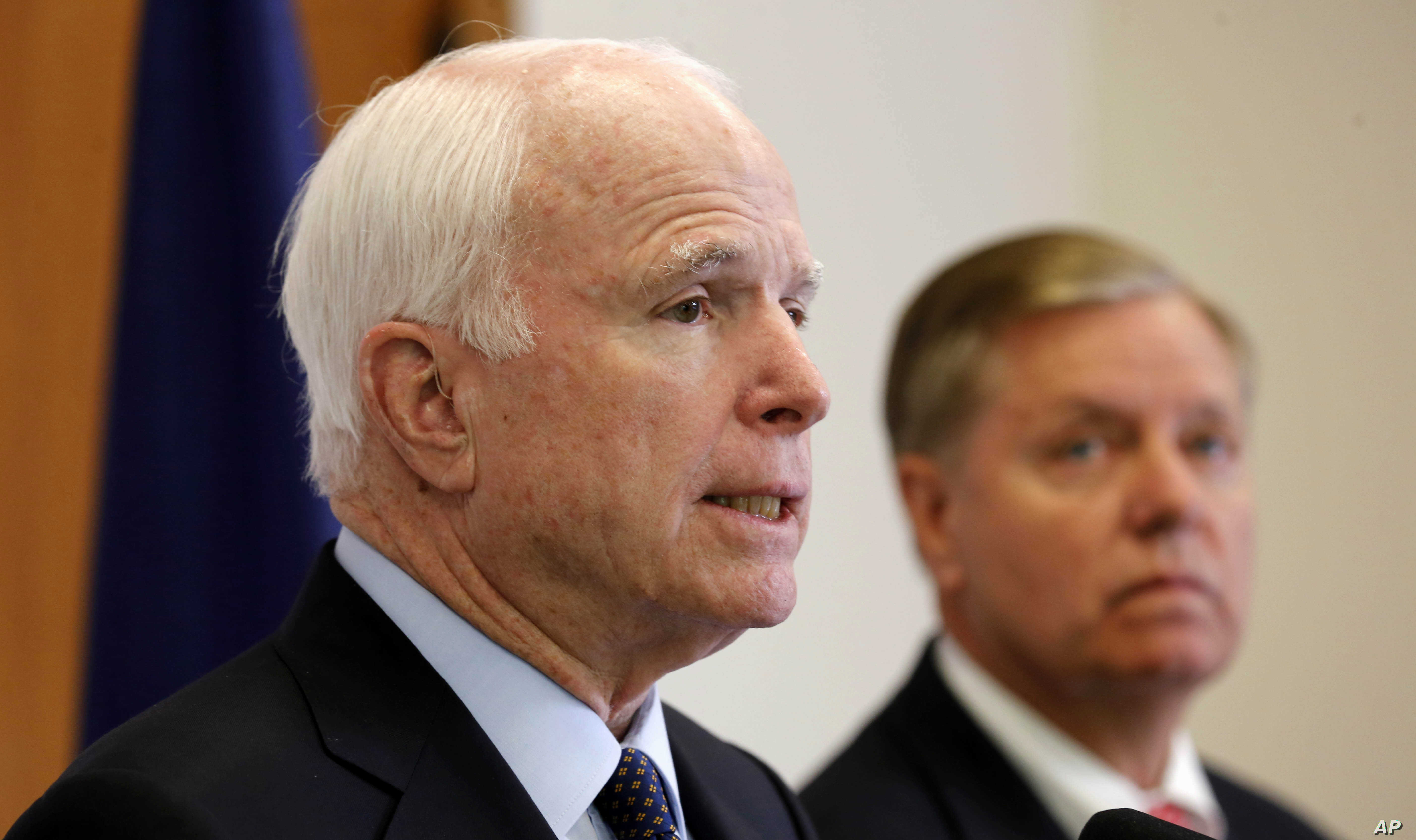 FILE - Republican presidential candidate Sen. Lindsey Graham, R-S.C. listens at right as former Republican presidential nominee, Sen. John McCain, R-Ariz.  talks about his support for Graham during a campaign stop, Friday, Sept. 11, 2015, in Manchest...