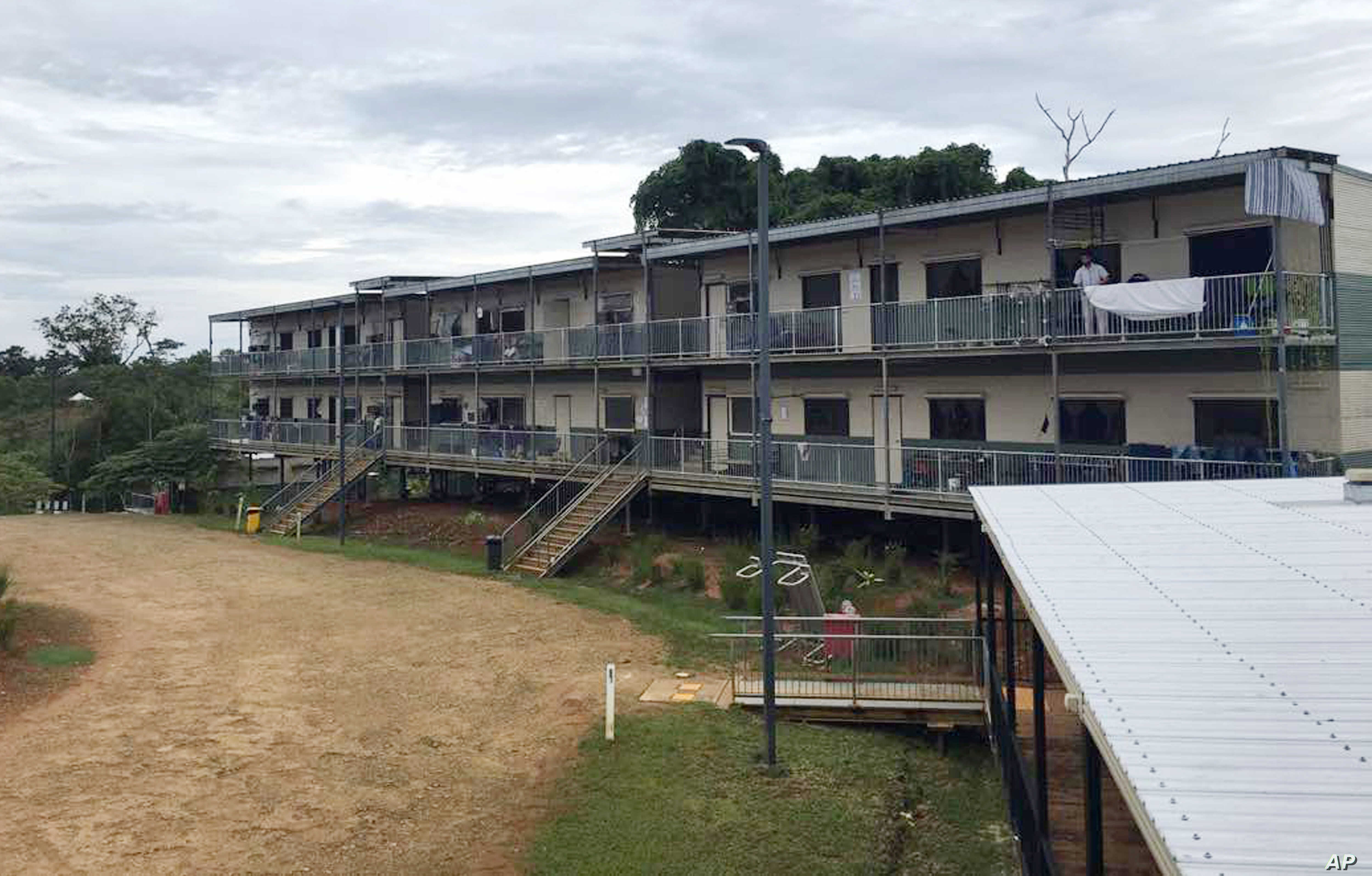 n this July 17, 2018,  a man standing on a balcony at the East Lorengau Refugee Transit Center on Manus Island, Papua New Guinea.