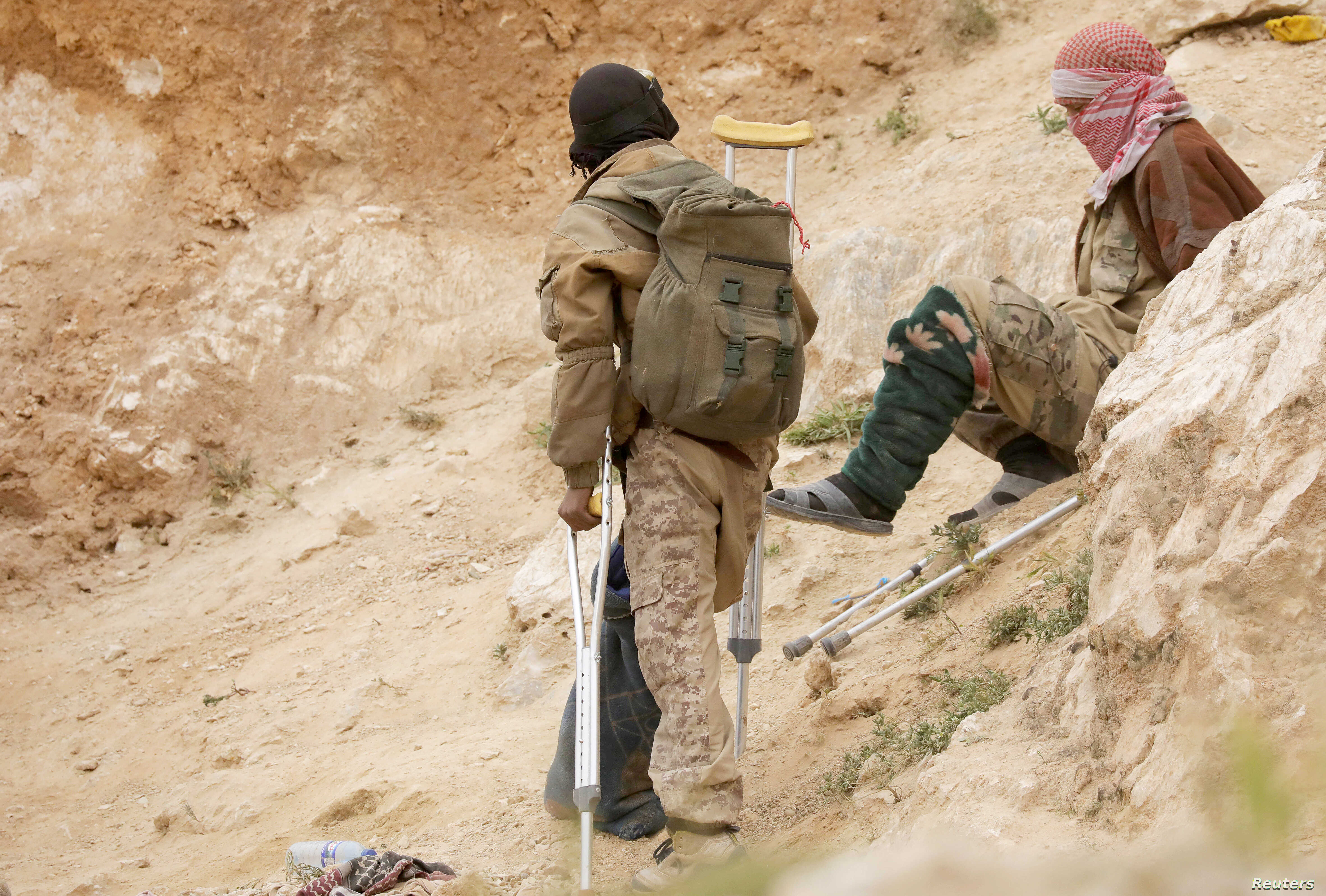 Injured Islamic state militants are seen in the village of Baghouz, Deir Al Zor province, Syria, March 14, 2019.