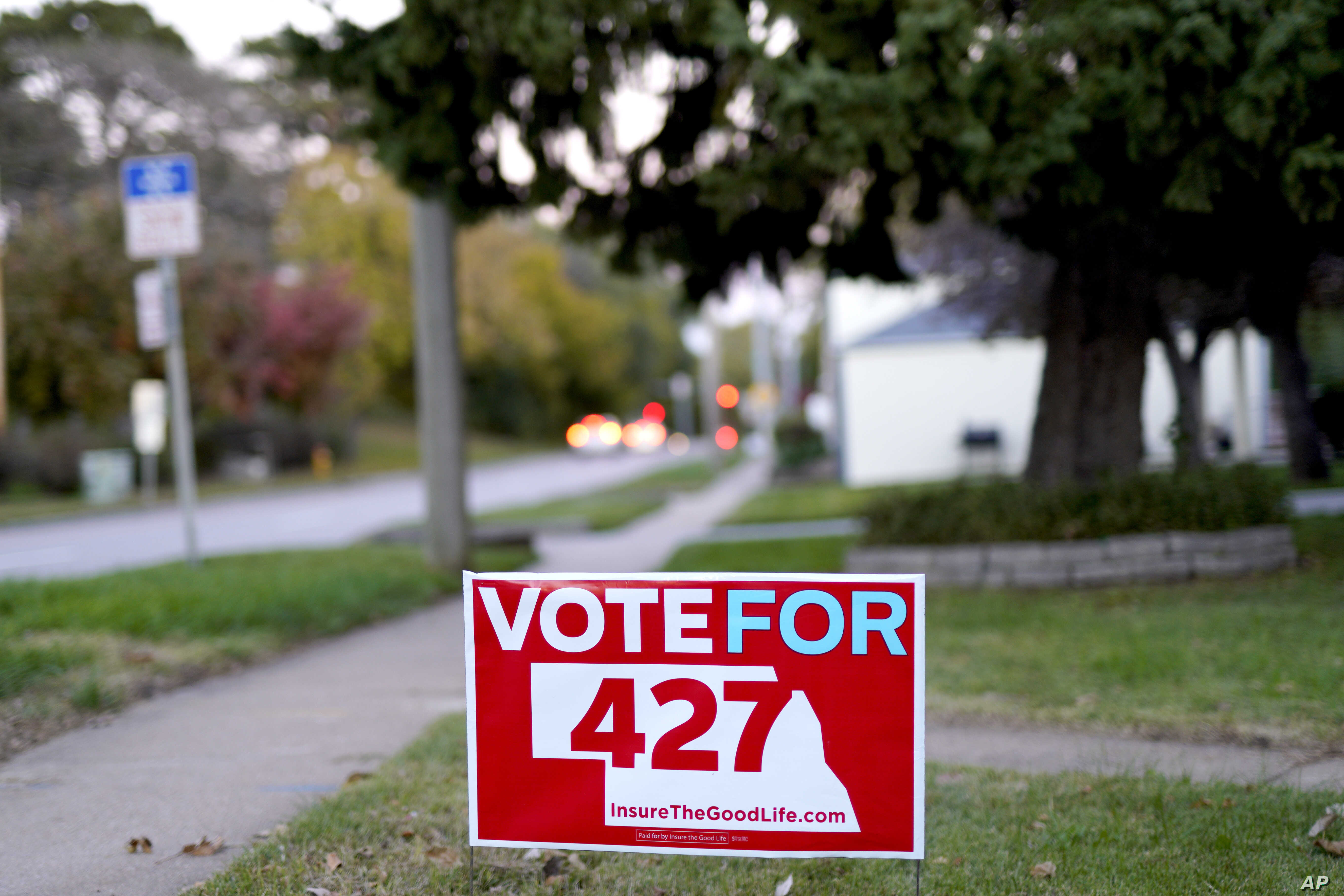 FILE - A yard sign promoting Initiative 427, the Medicaid Expansion Initiative, is seen in Omaha, Neb., Oct. 17, 2018. For nearly a decade, opposition to Obama's health care law has been a winning message for Nebraska Republicans, helping them take e...