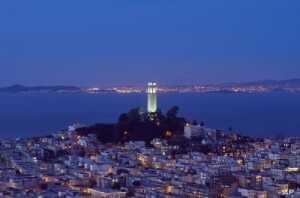"""In the distance behind Coit Tower atop Telegraph Hill, lies the """"inescapable"""" Alcatraz Prison. A few convicts escaped took their chances in the bay's icy waters. None is thought to have made it to shore."""