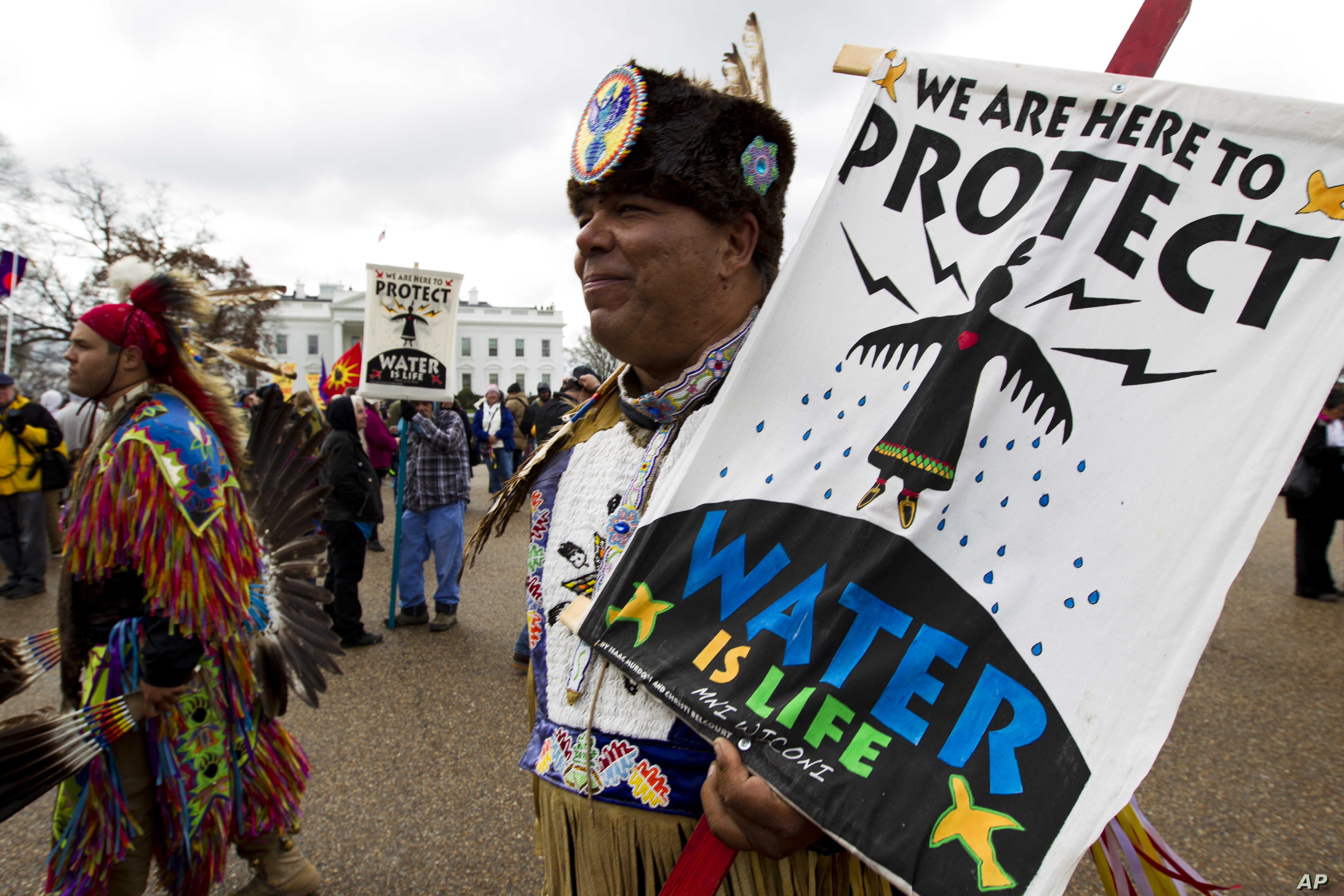 America Indians and their supporters protest outside of the White House, March 10, 2017, in Washington, to rally against the construction of the disputed Dakota Access oil pipeline.