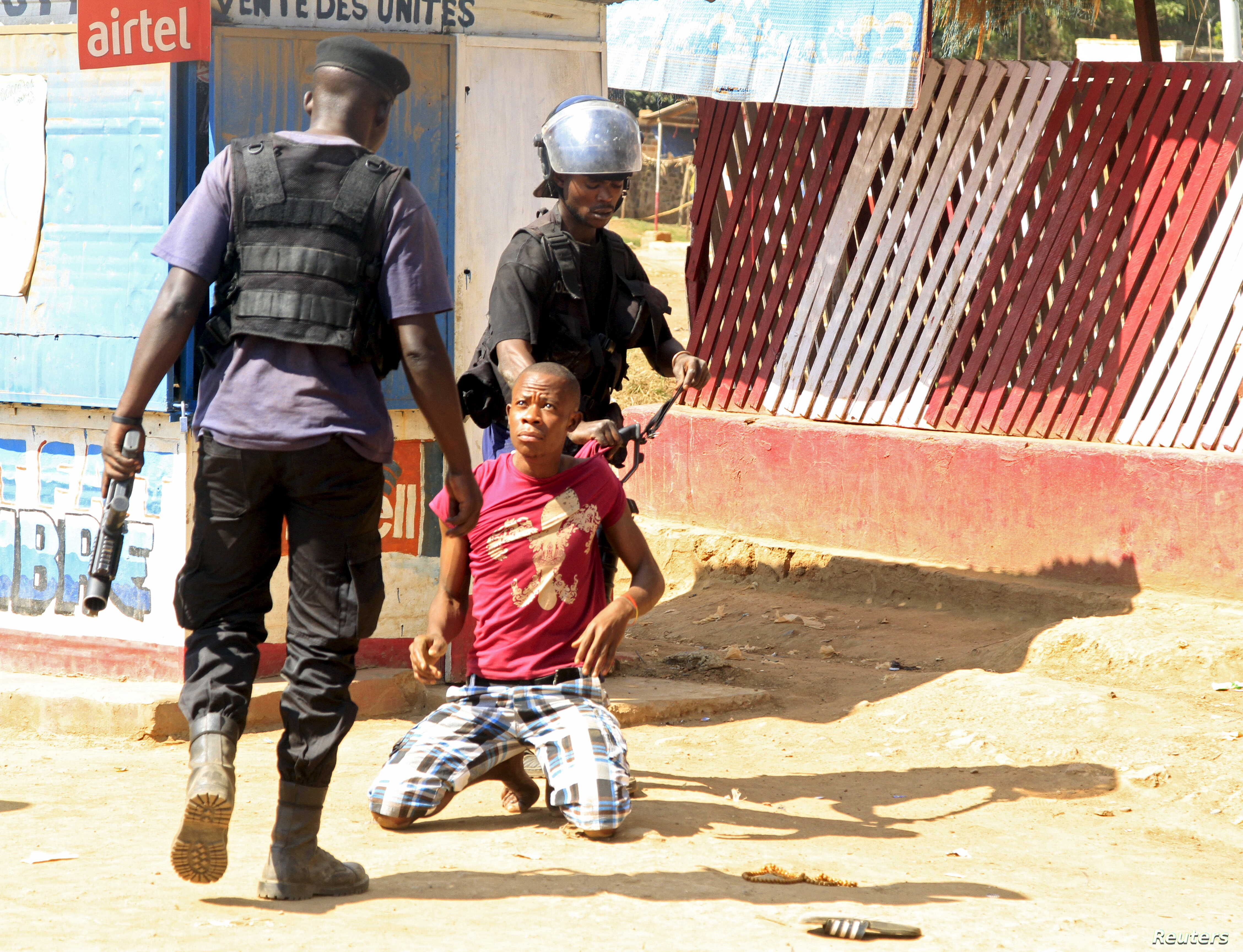 Policemen detain a protester during clashes in Lubumbashi, Democratic Republic of Congo, Nov. 10, 2015.