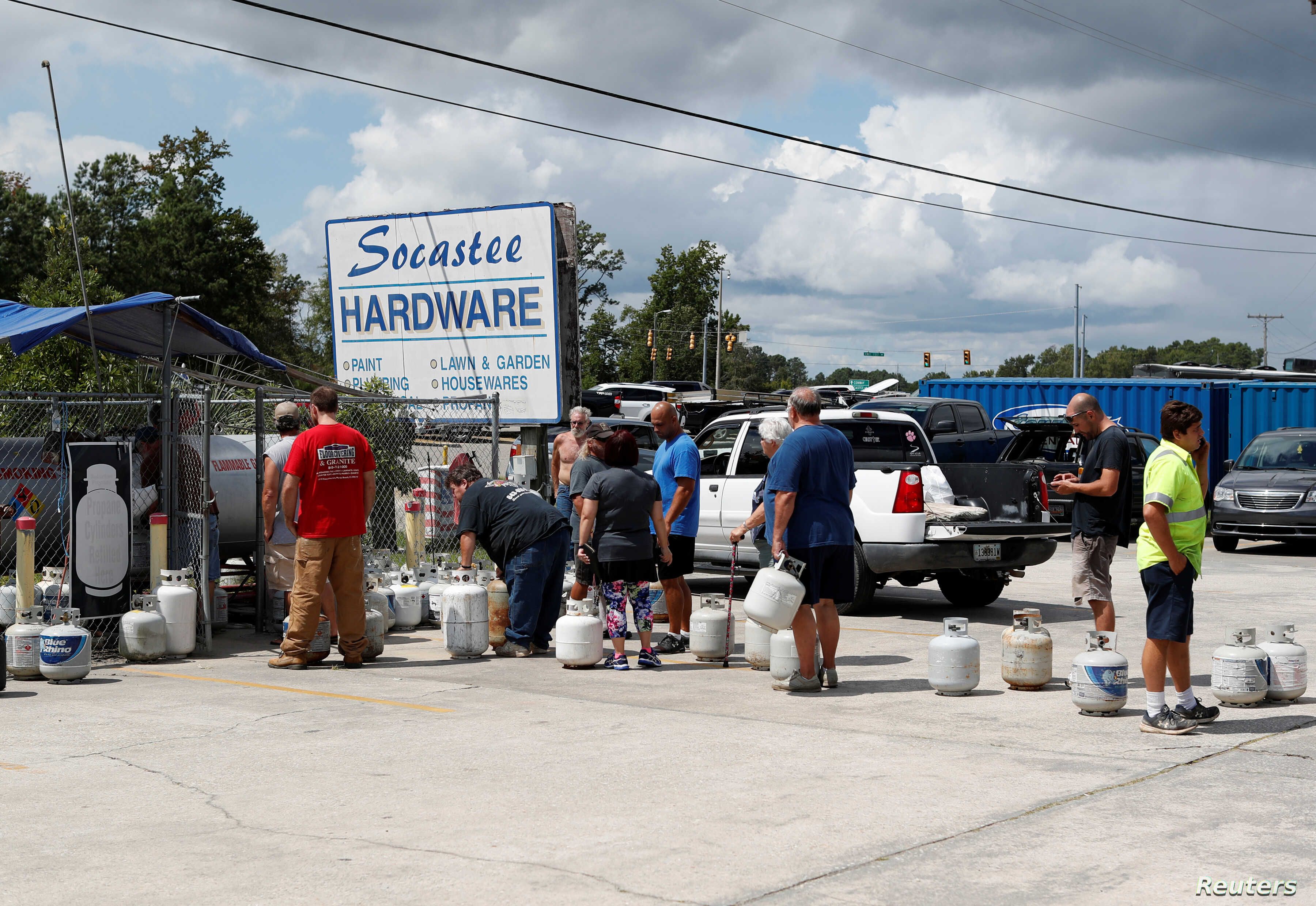 Customers line up to buy propane at Socastee Hardware store, ahead of the arrival of Hurricane Florence in Myrtle Beach, South Carolina, Sept. 10, 2018.