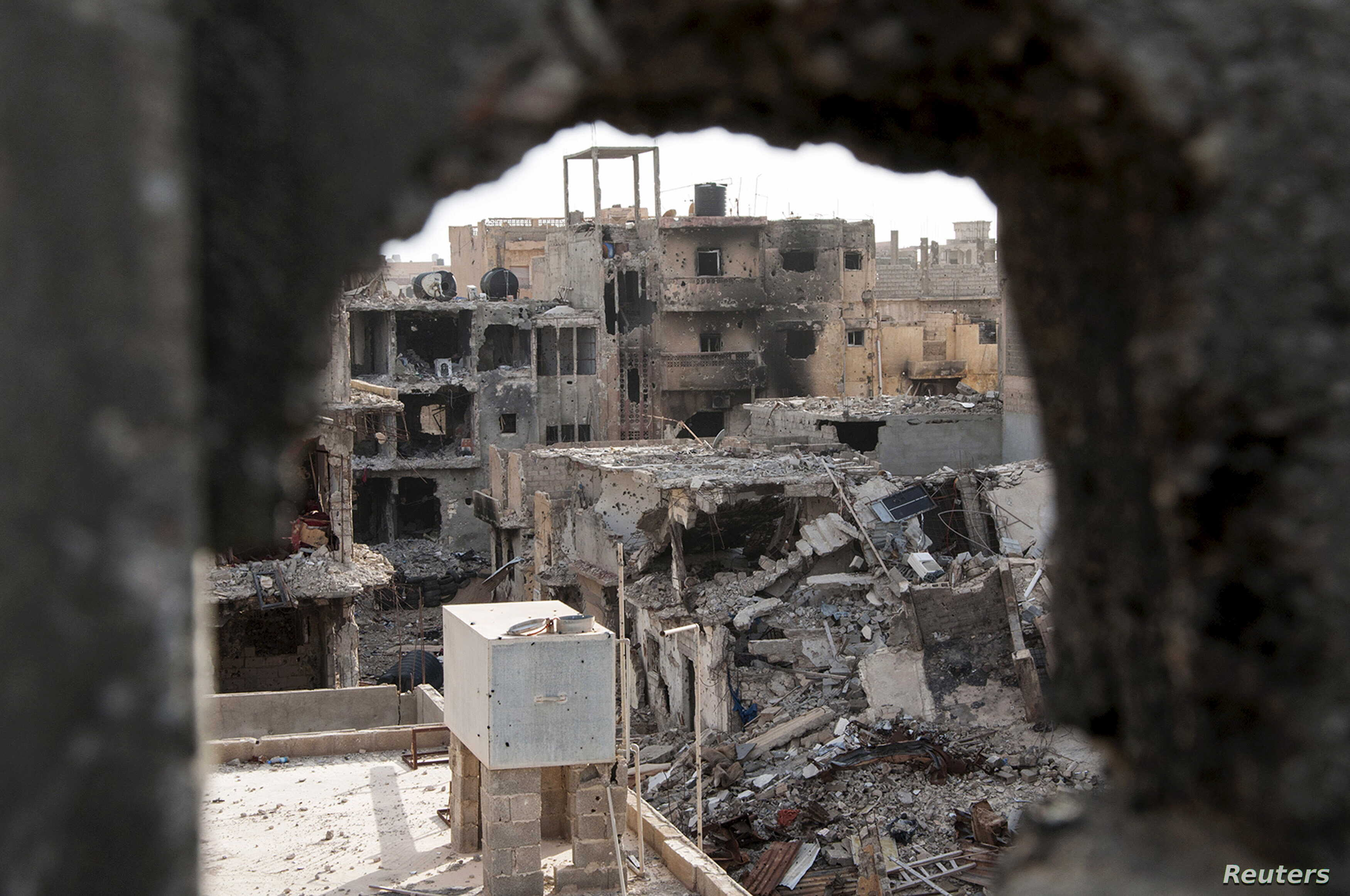 Damaged buildings are pictured after clashes between members of the Libyan pro-government forces and the Shura Council of Libyan Revolutionaries, an alliance of former anti-Gaddafi rebels who have joined Islamist group Ansar al-Sharia, in Benghazi, L...