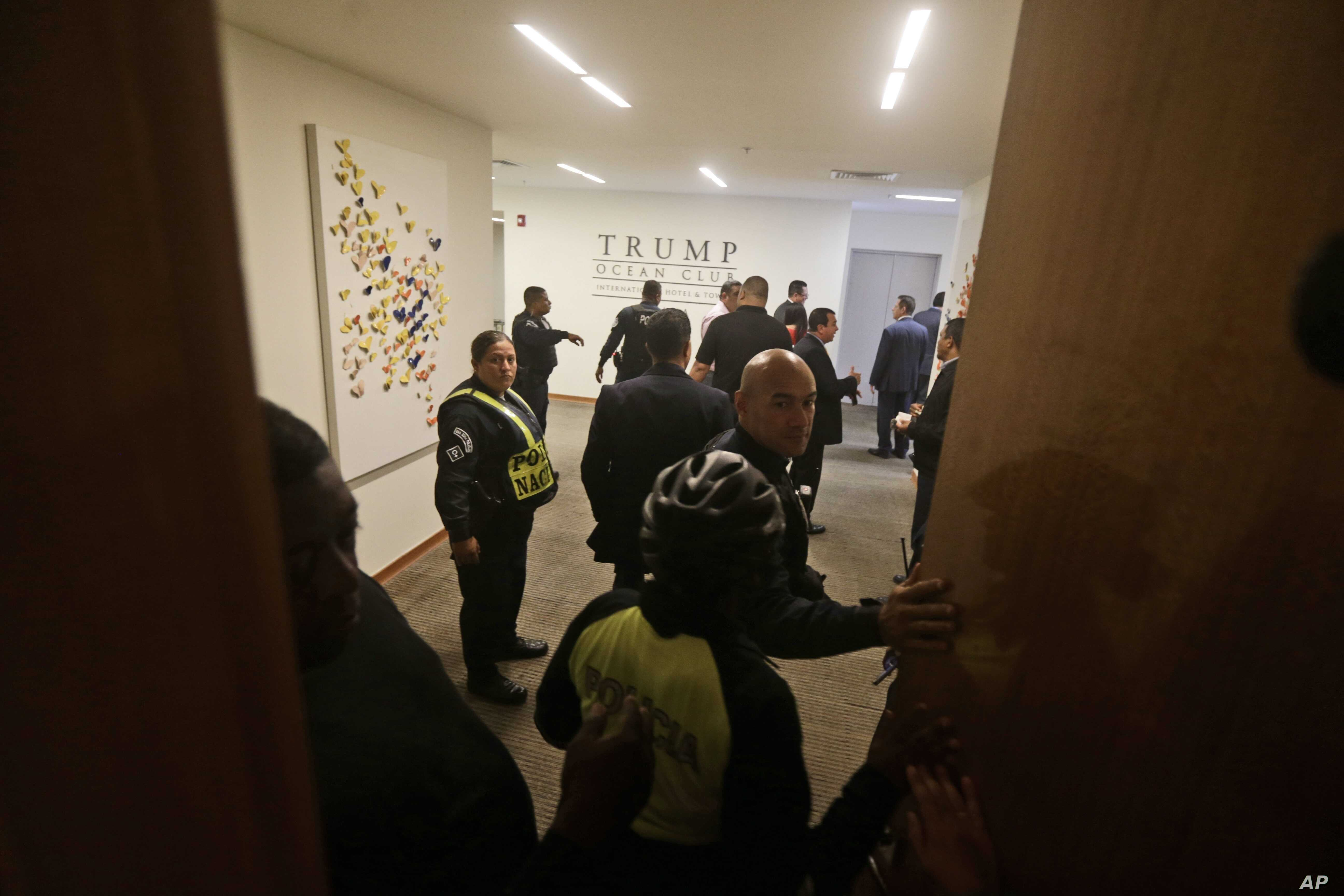 A group of Panamanian police officers stand inside the Trump Ocean Club International Hotel and Tower in Panama City, March 5, 2018.