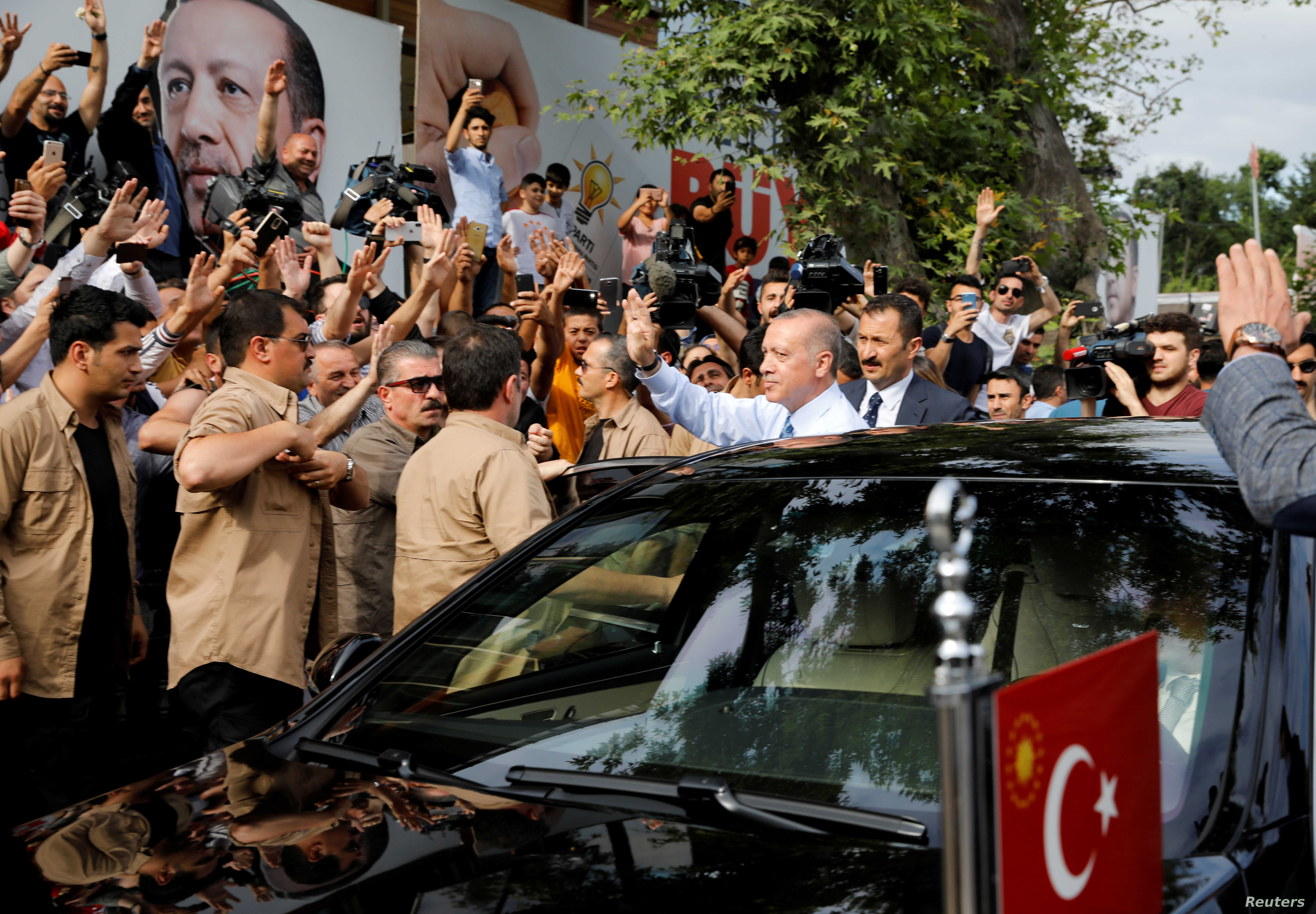 Turkish President Tayyip Erdogan waves to supporters as he leaves his residence in Istanbul, Turkey, June 24, 2018.