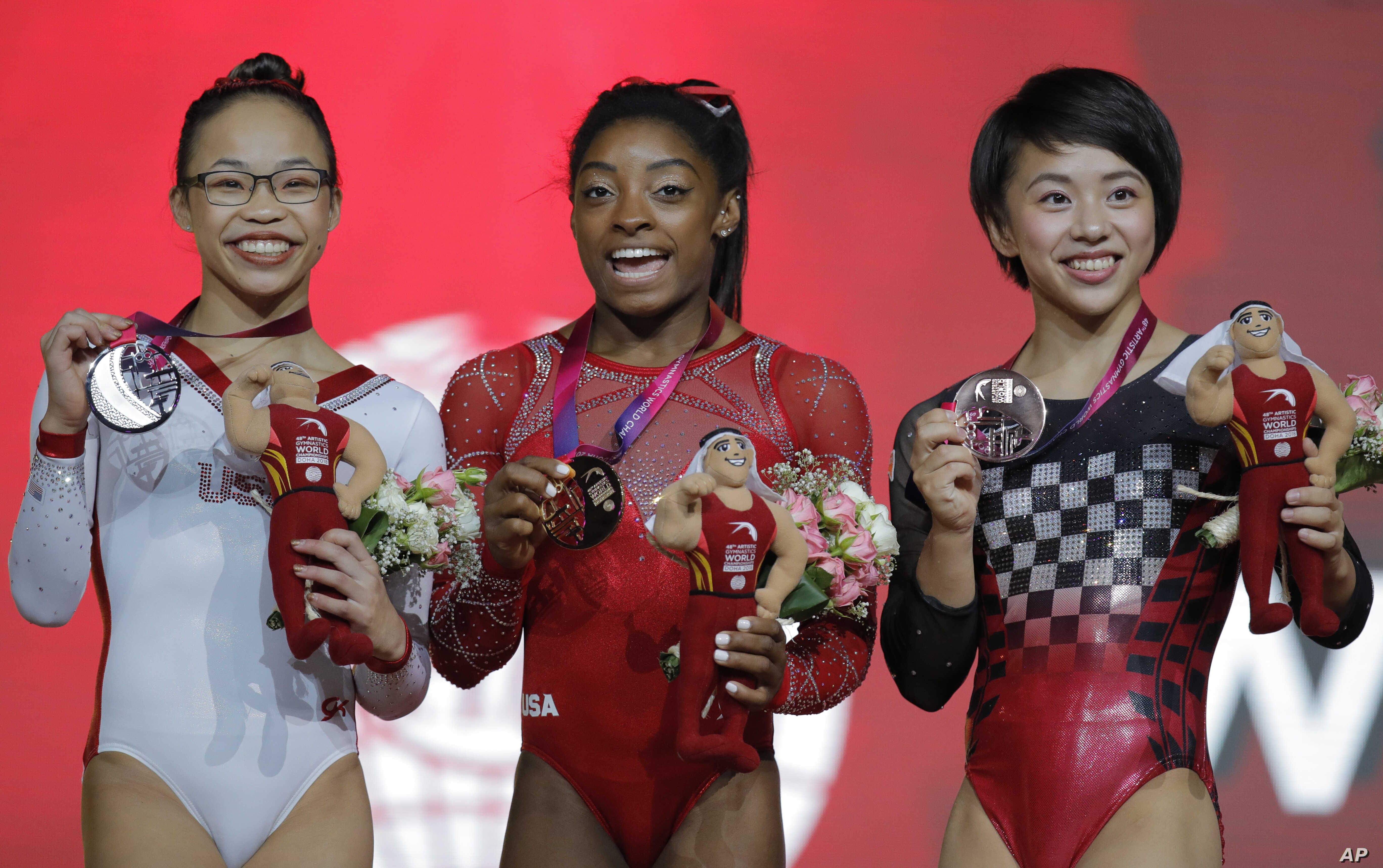 FILE - Gold medalist Simone Biles of the U.S., center, silver medalist Morgan Hurd of the U.S., left, and bronze medalist Japan's Mai Murakami pose after their floor exercise on the second and last day of the apparatus finals of the Gymnastics World ...