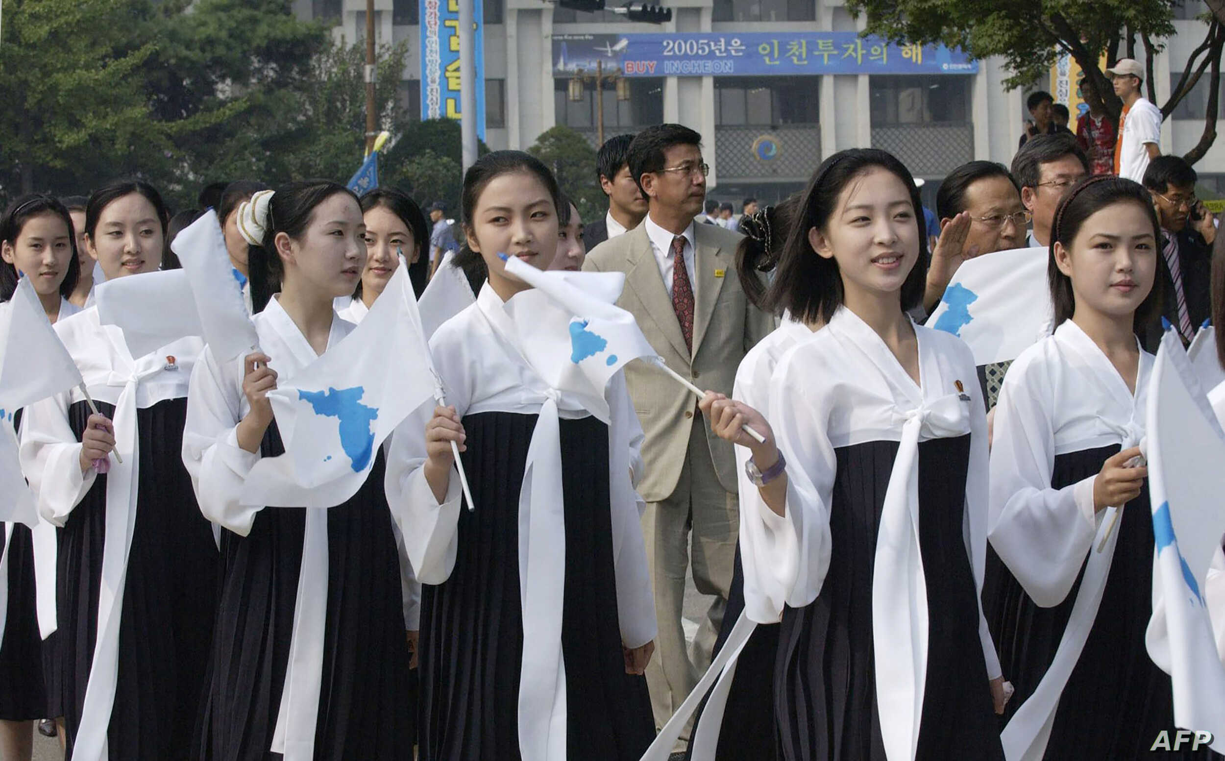 In this 2005 photo, North Korea's female cheerleaders, including a woman (right)  believed to be North Korean leader Kim Jong-Un's current wife Ri Sol-Ju, attend the 2005 Asian Athletics Championships in Incheon.
