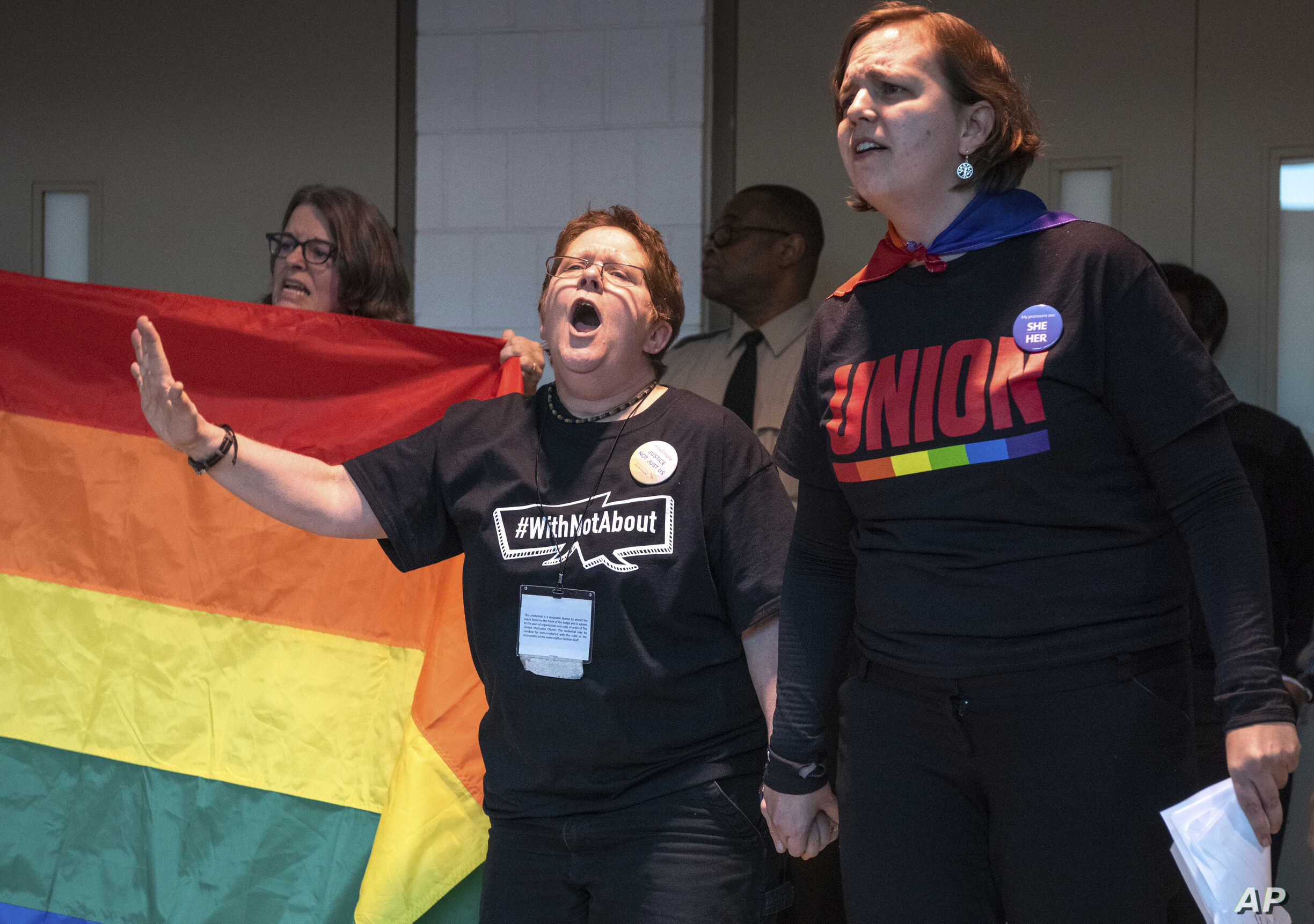 Protesters objecting to the adoption of the Traditional Plan gather and protest outside the United Methodist Church's 2019 Special Session of the General Conference in St. Louis, Mo., Feb. 26, 2019.