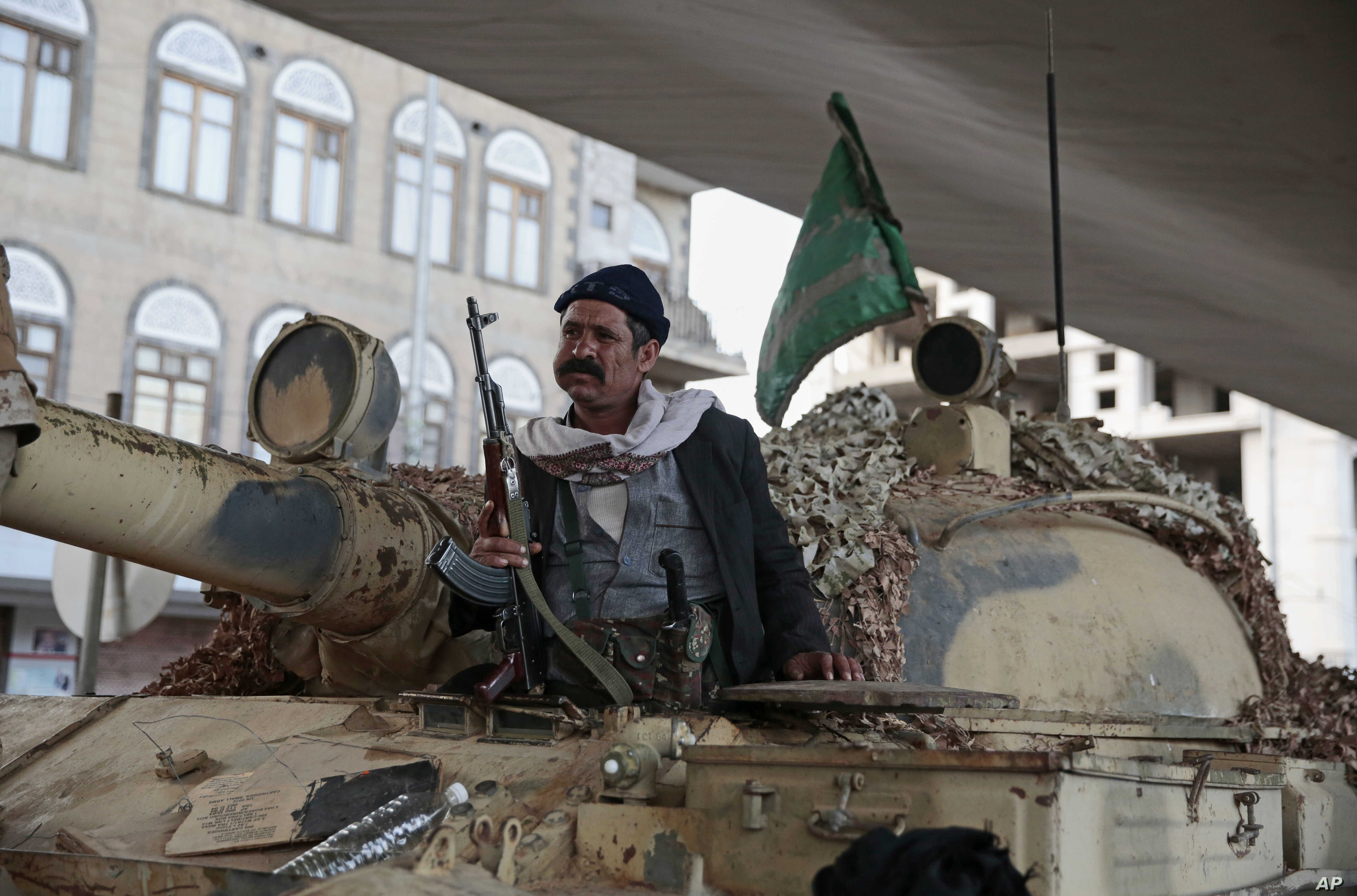 A Houthi Shi'ite fighter guards a street leading to the residence of former President Ali Abdullah Saleh, in Sana'a, Yemen, Dec. 4, 2017.