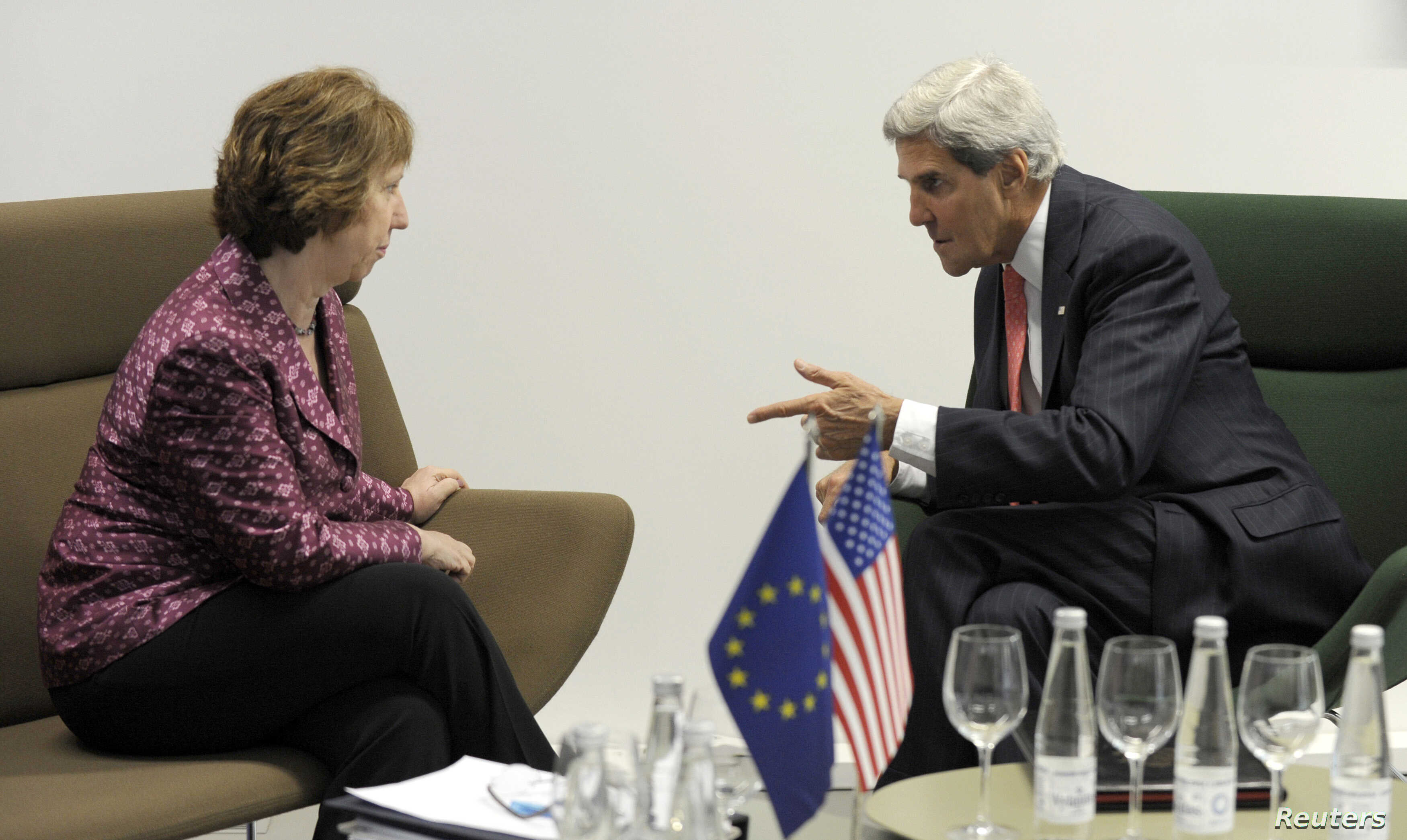 U.S. Secretary of State John Kerry (R) meets with European Union High Representative Catherine Ashton before a meeting of EU ministers of foreign affairs at the National Gallery of Art in Vilnius, Sept. 7, 2013.