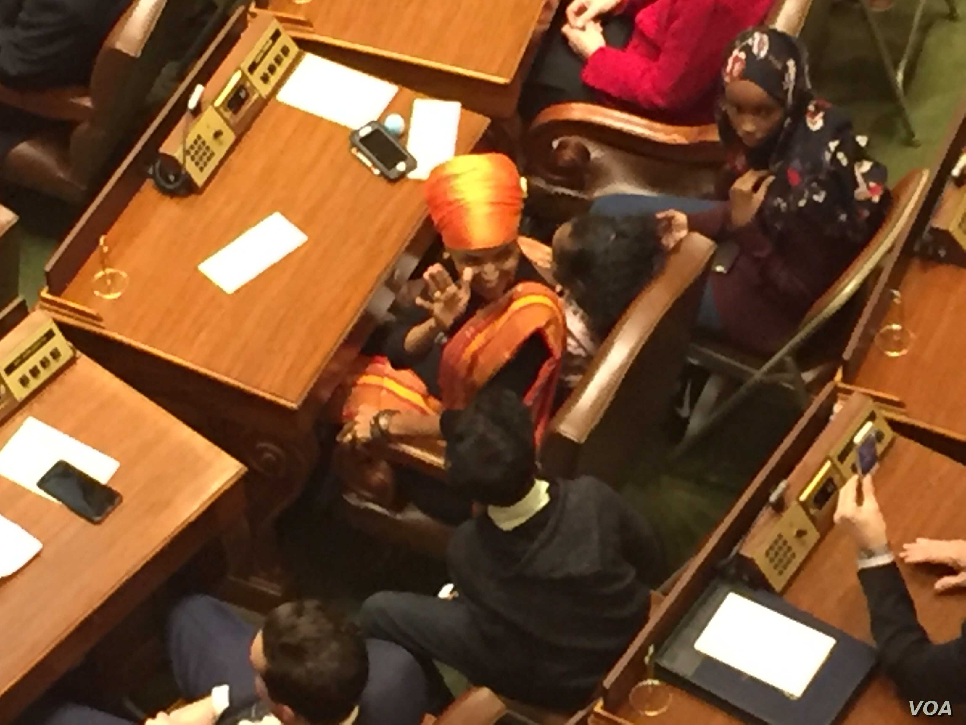 Ilhan Omar's first day as a Minnesota legislator. This photo was taken right before her inauguration. (K. Farabaugh/VOA)