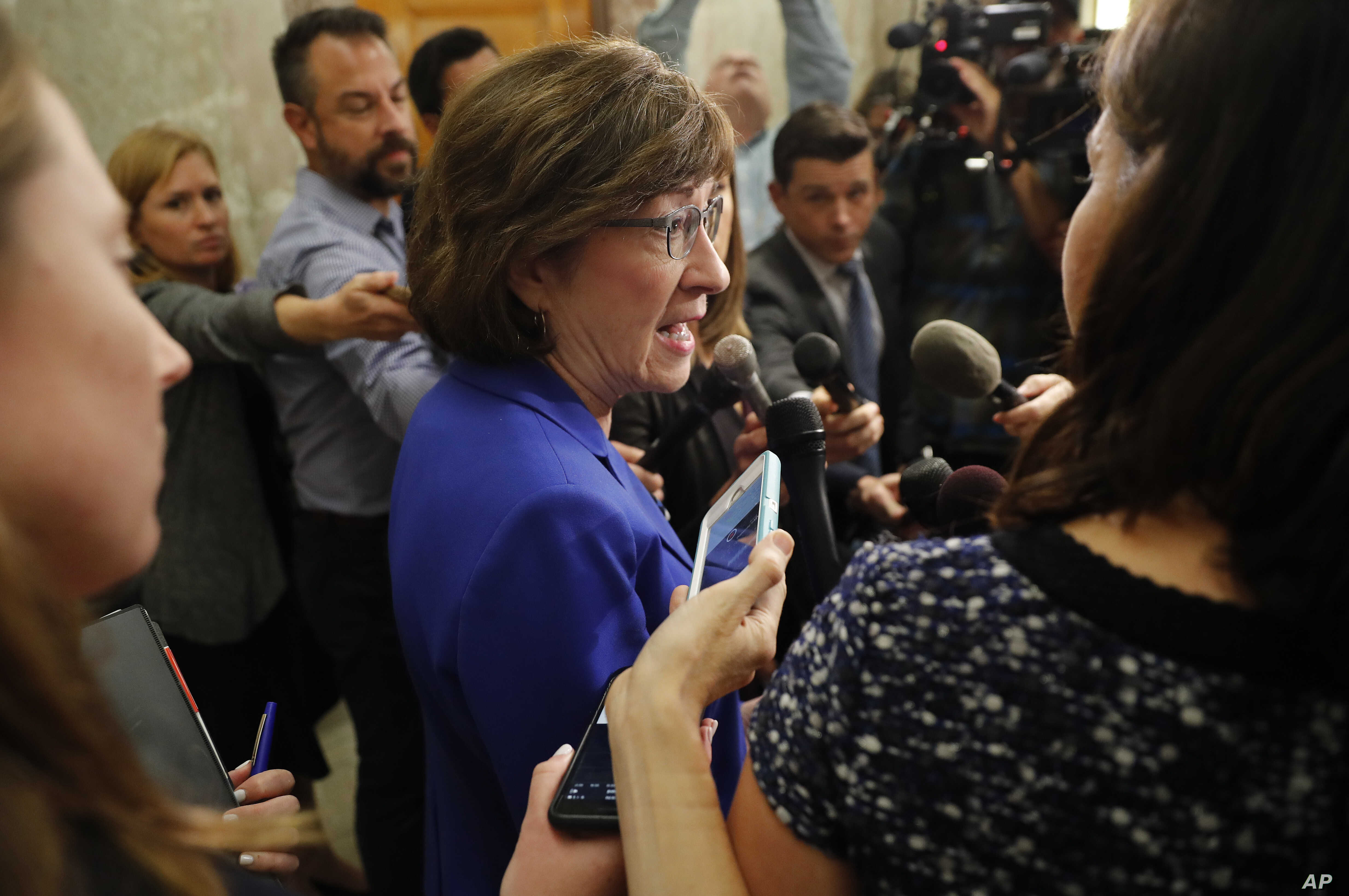 Sen. Susan Collins, R-Maine, speaks to members of the media outside her office on Capitol Hill in Washington, Sept. 17, 2018.
