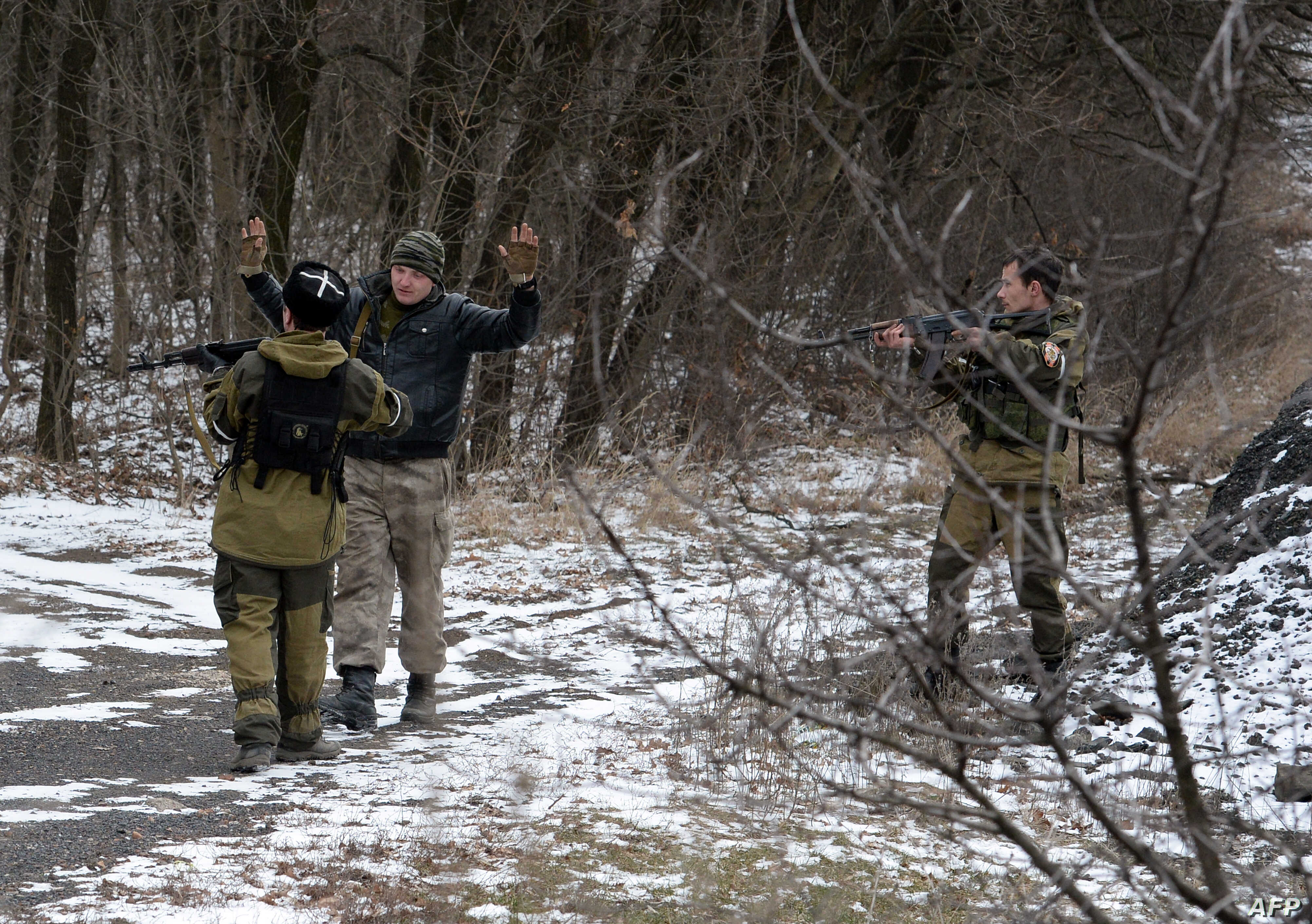 Pro-Russian separatists question a man in the eastern Ukrainian city of Uglegorsk, six kilometers southwest of Debaltseve, Feb. 19, 2015. The leaders of Ukraine, Germany, France and Russia pledged to try to save the tattered cease-fire.