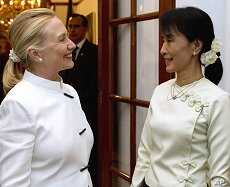 U.S. Secretary of State Hillary Clinton and Aung San Suu Kyi talk prior to dinner at the U.S. Chief of Mission residence in Rangoon, Dec. 1, 2011.