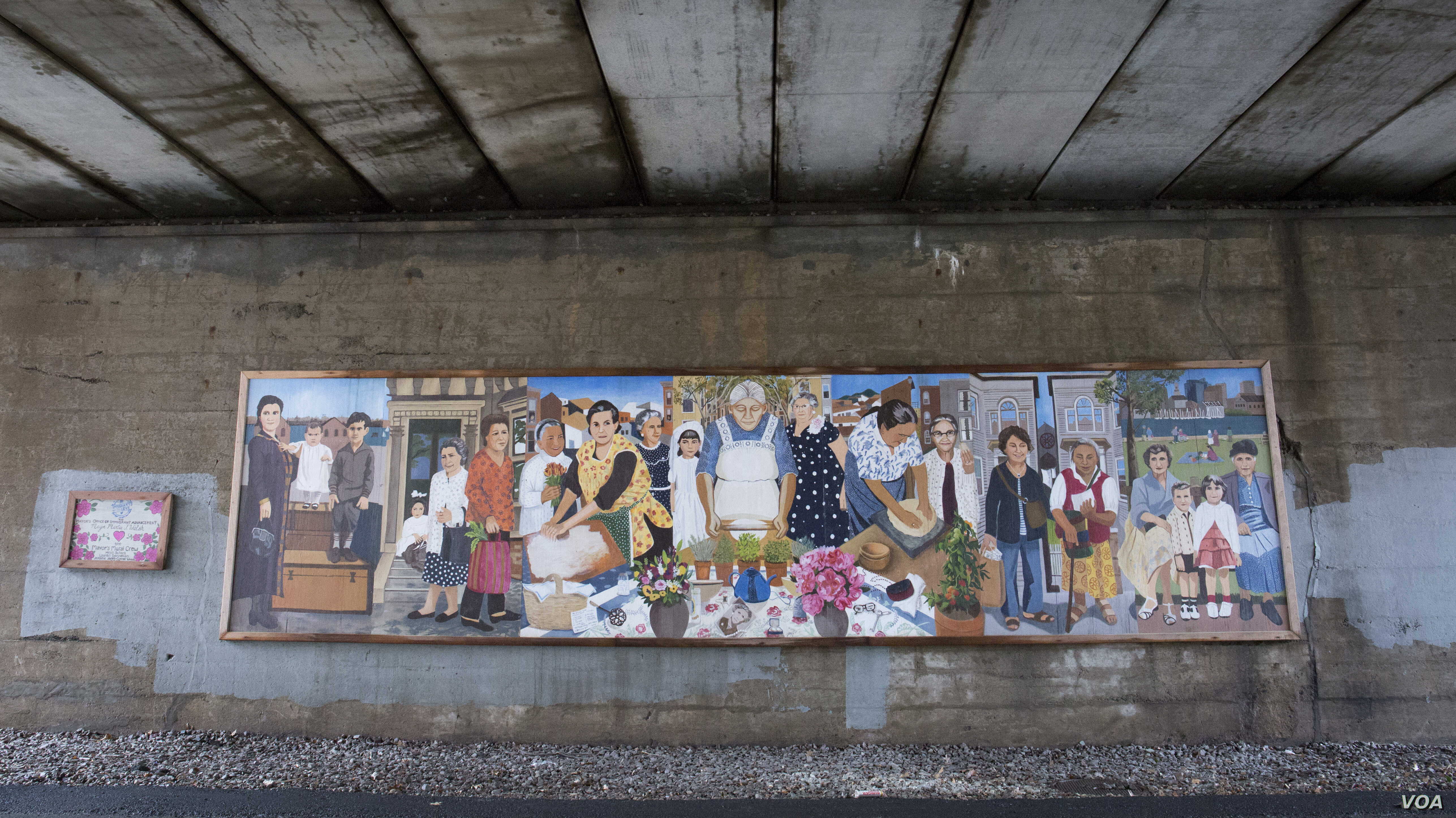 """Using photos of local grandmothers as inspiration, an East Boston """"Immigrant Grandmothers"""" mural aims to capture the similarities of each generation's stories in a single frame."""