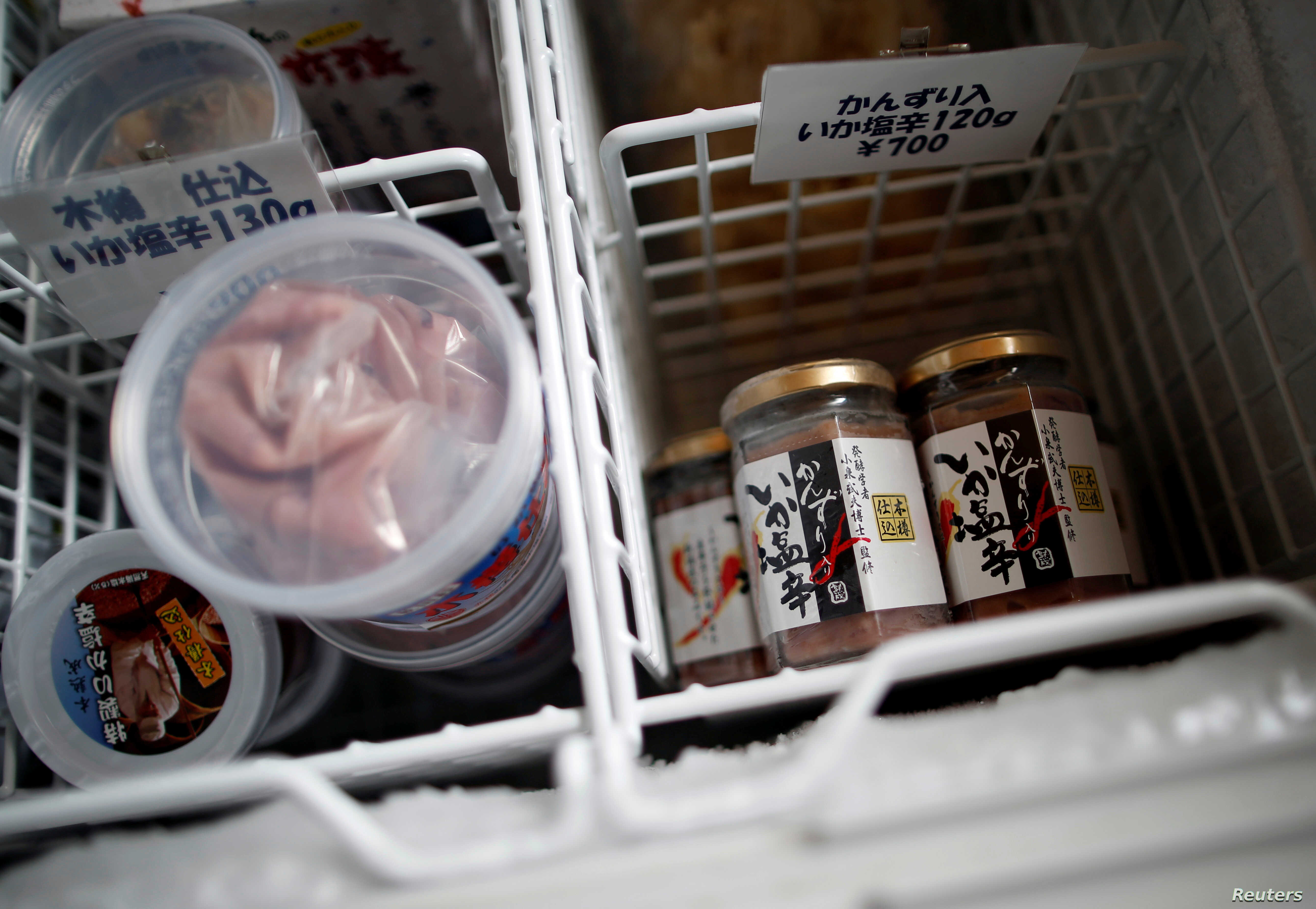 Products of 'Shio-kara', a traditional fermented squid dish, are seen inside a freezer at a factory owned by Takashi Odajima in Hakodate, Hokkaido, Japan, July 19, 2018.
