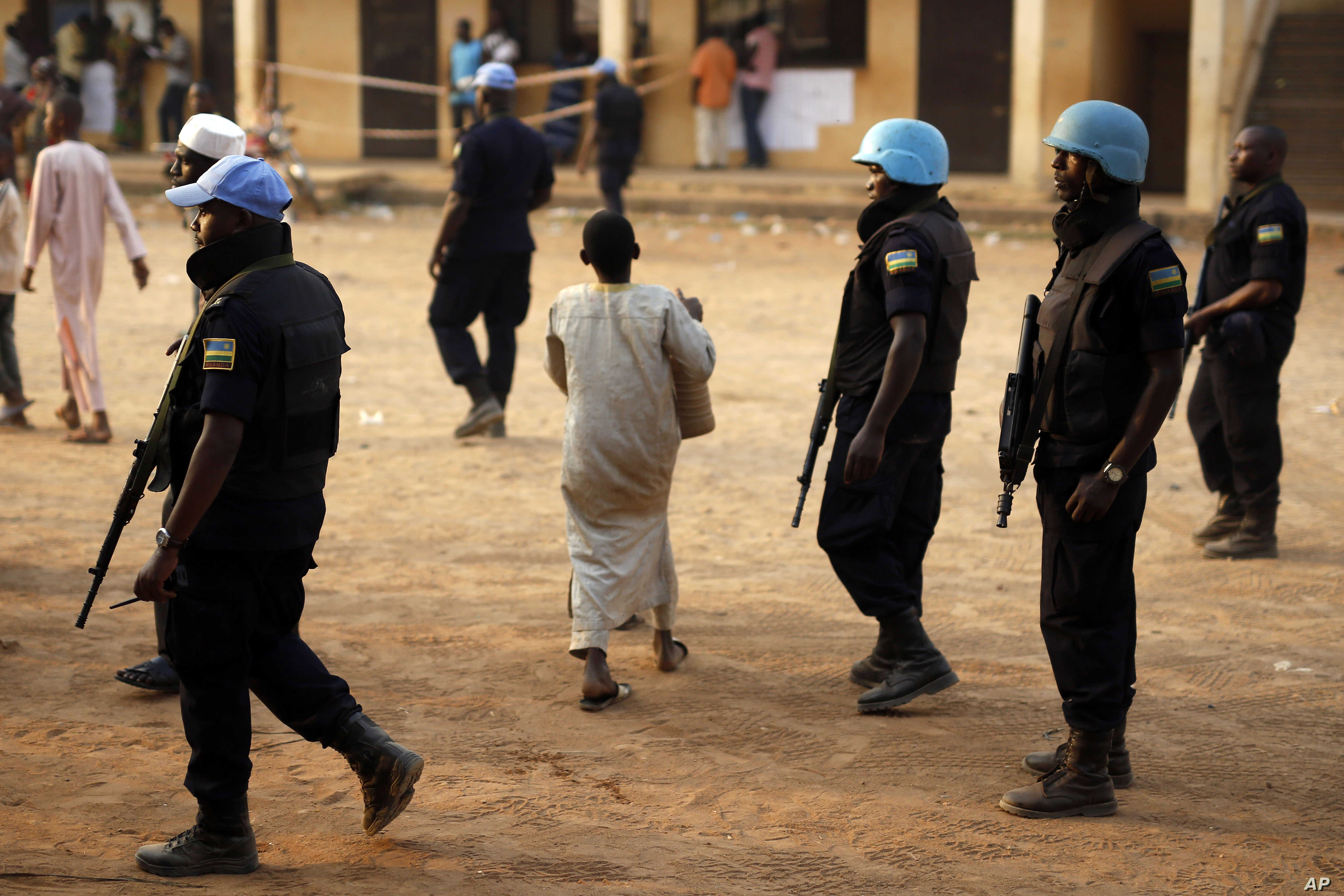 U.N. peacekeepers are seen on patrol in Bangui, capital of the Central African Republic, Feb. 14, 2016. One Cambodian U.N. peacekeeper was killed and eight others were wounded Tuesday in an attack near the town of Bangassou, about 730 km east of Bang...