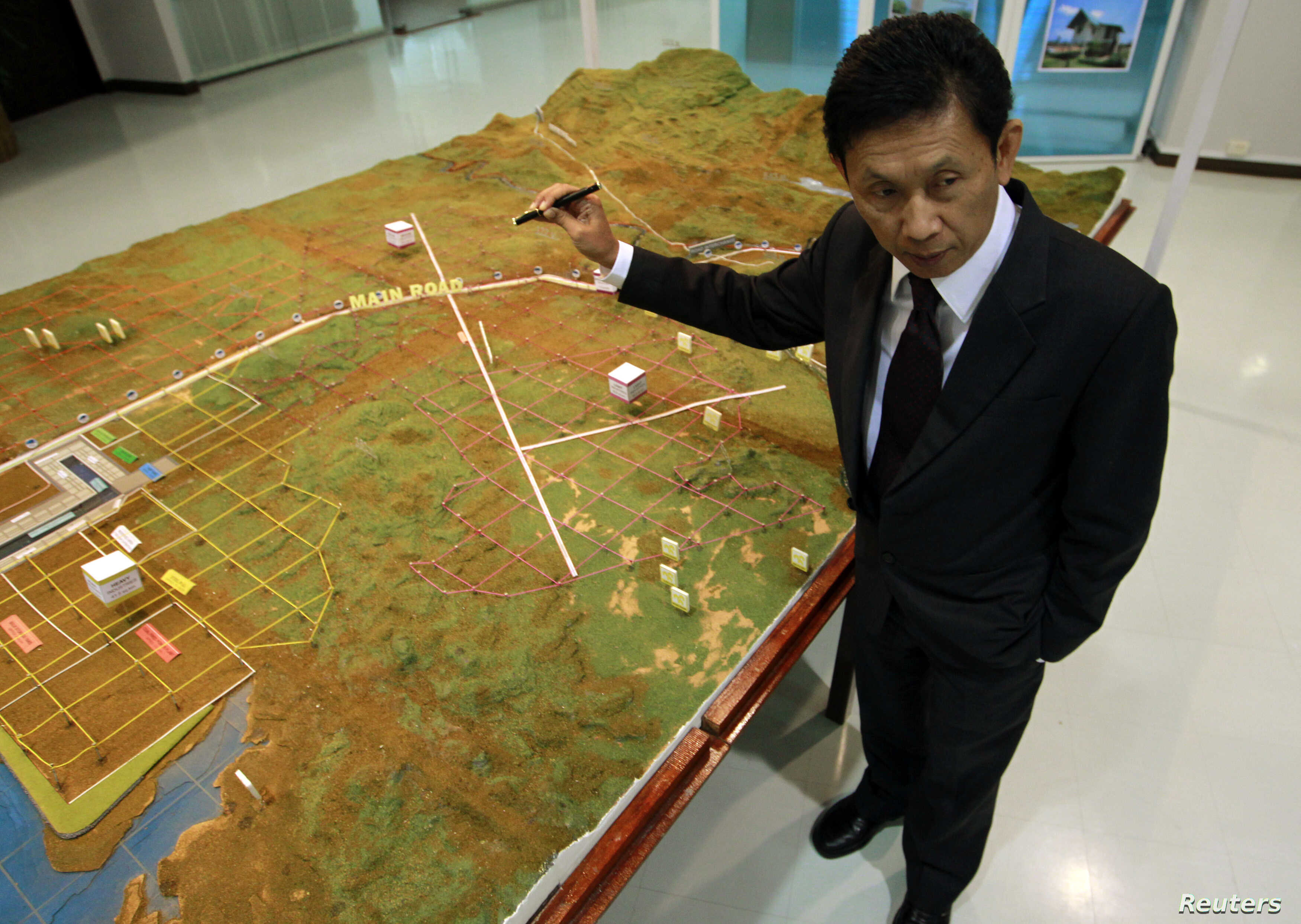FILE - Dawei Development Company's Managing Director Somjet Thinaphong shows a model of the Dawei economic zone during an interview in Bangkok, Sept. 19, 2012.