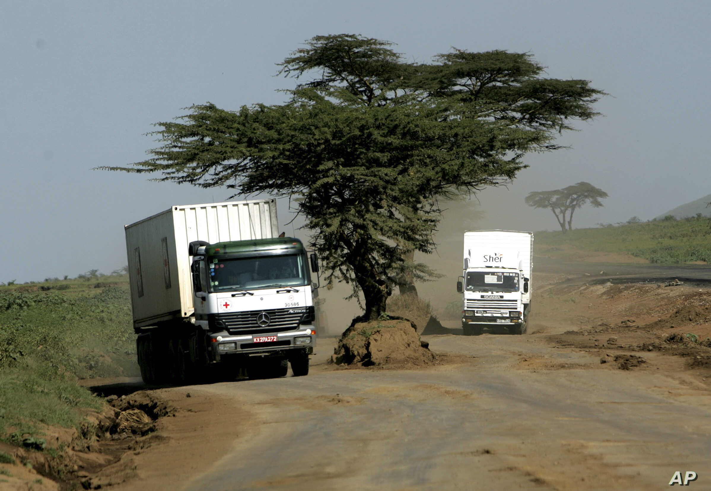 ** FILE ** A Red Cross truck travels on a dirt road, Monday, Feb. 12, 2007, outside the Kenyan town of Naivasha. The most important highway in East Africa starts at the Indian Ocean port of Mombasa. Tens of thousands of trucks every year carry food, ...