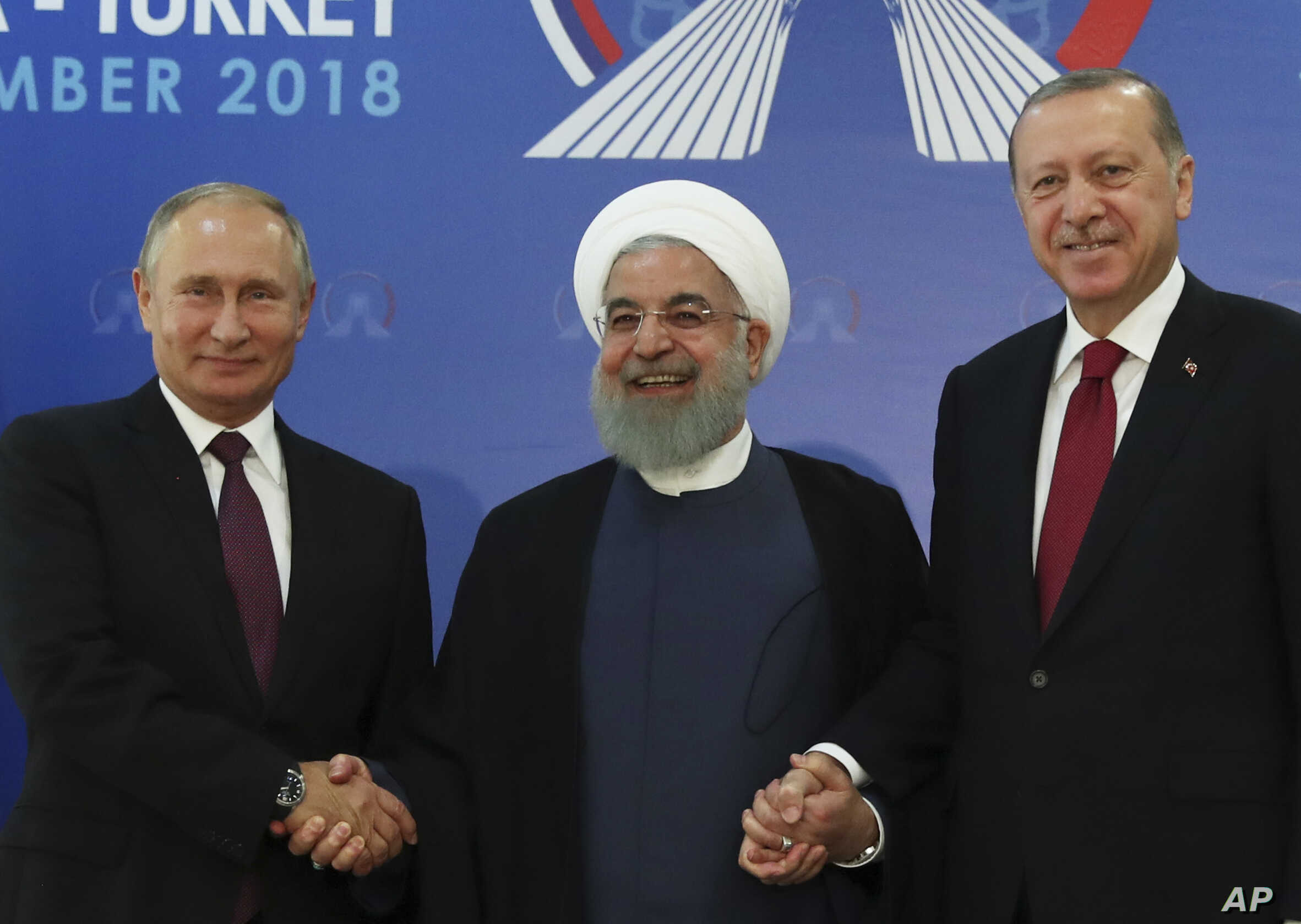 Iran's President Hassan Rouhani, center, flanked by Russia's President Vladimir Putin, left, and Turkey's President Recep Tayyip Erdogan, pose for photographs in Tehran, Iran, ahead of their summit to discuss Syria, Sept. 7, 2018.
