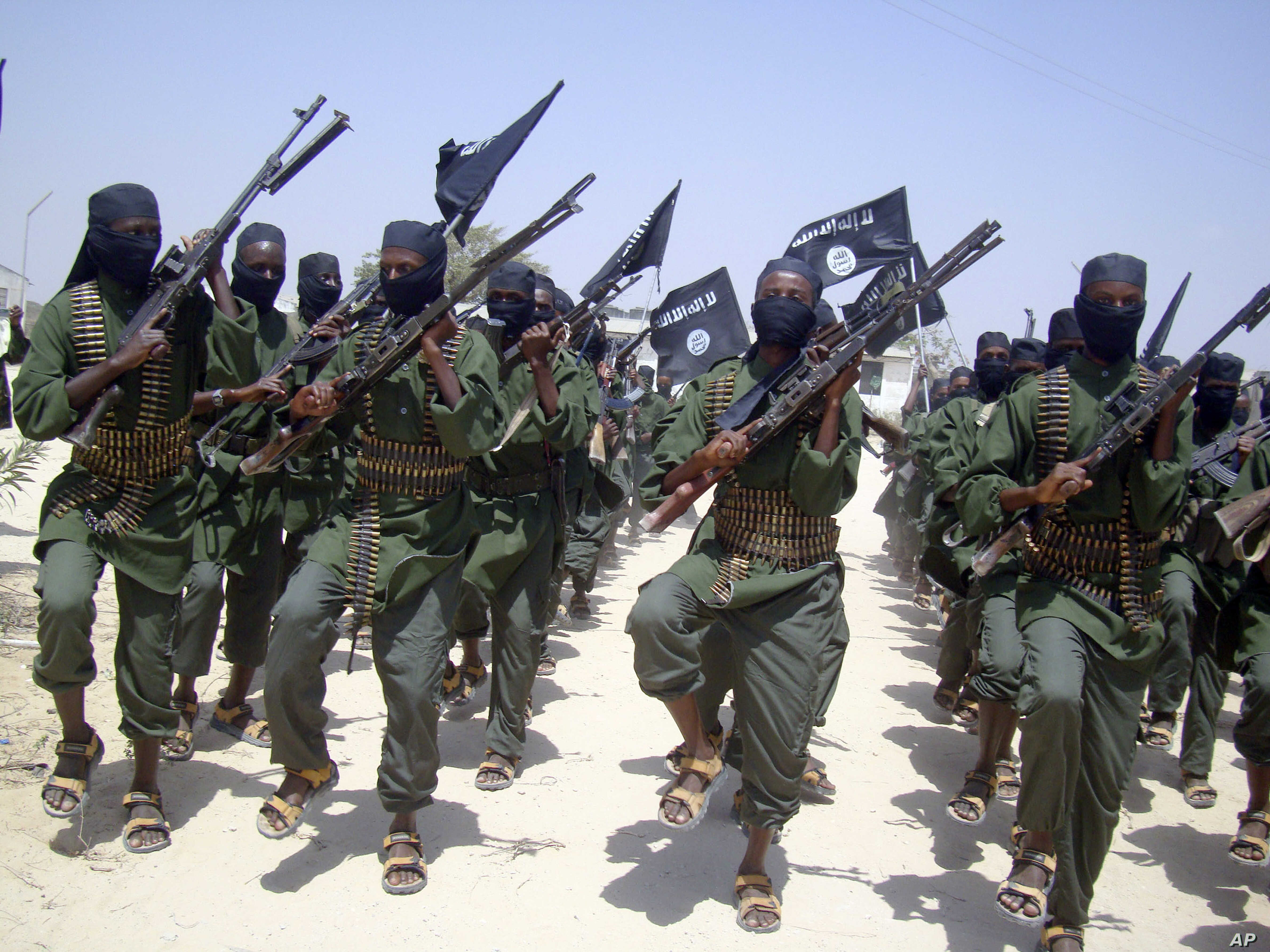 FILE - Al-Shabab fighters march with their weapons during military exercises on the outskirts of Mogadishu, Somalia, Feb. 17, 2011. Missiles fired Feb. 21, 2018, targeted a rickshaw carrying al-Shabab militants near Jamaame, in the southern Lower Jub