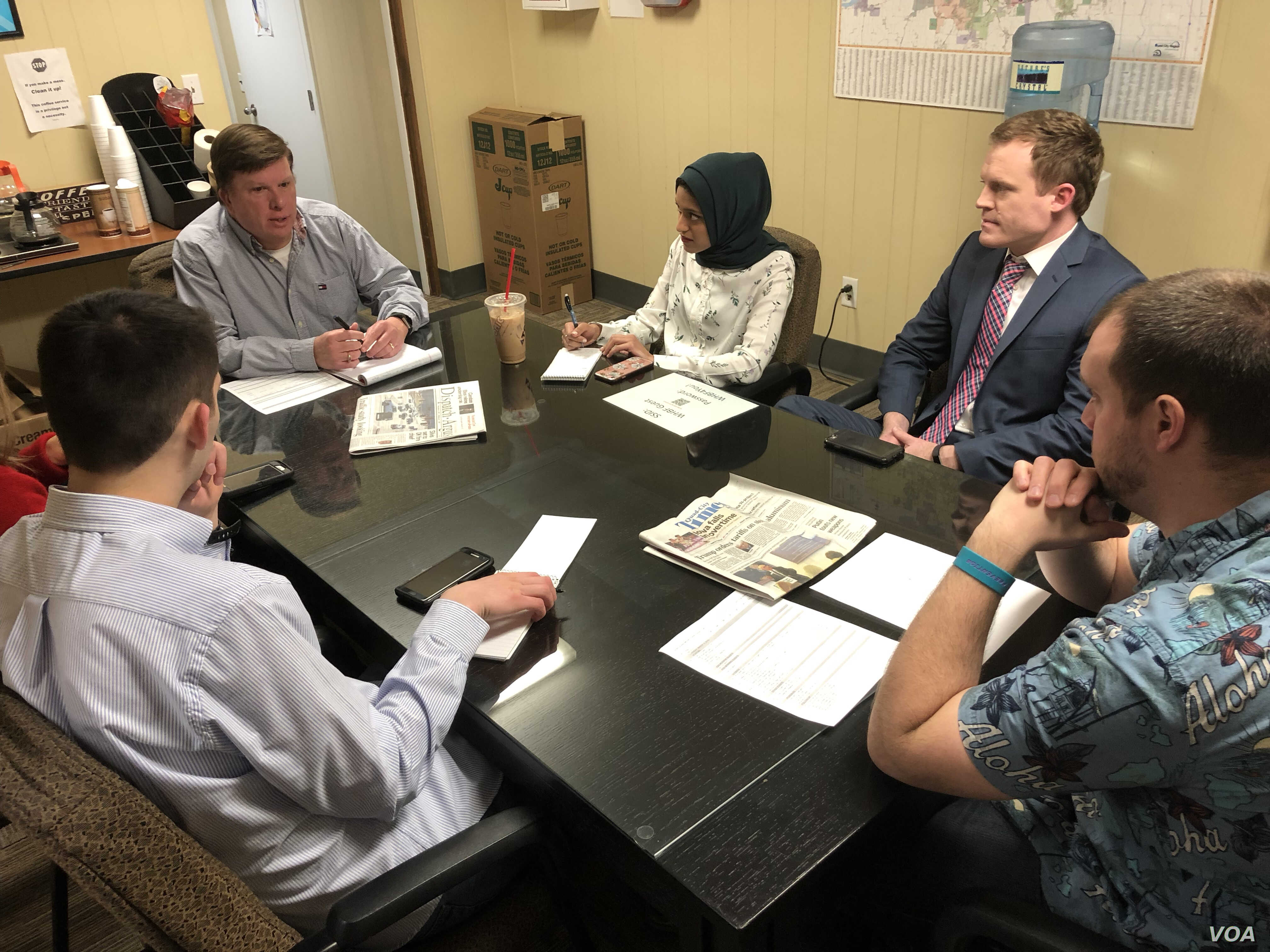 WHBF-TV News Director Mike Mickle and the news team discuss potential assignments at a morning editorial meeting.