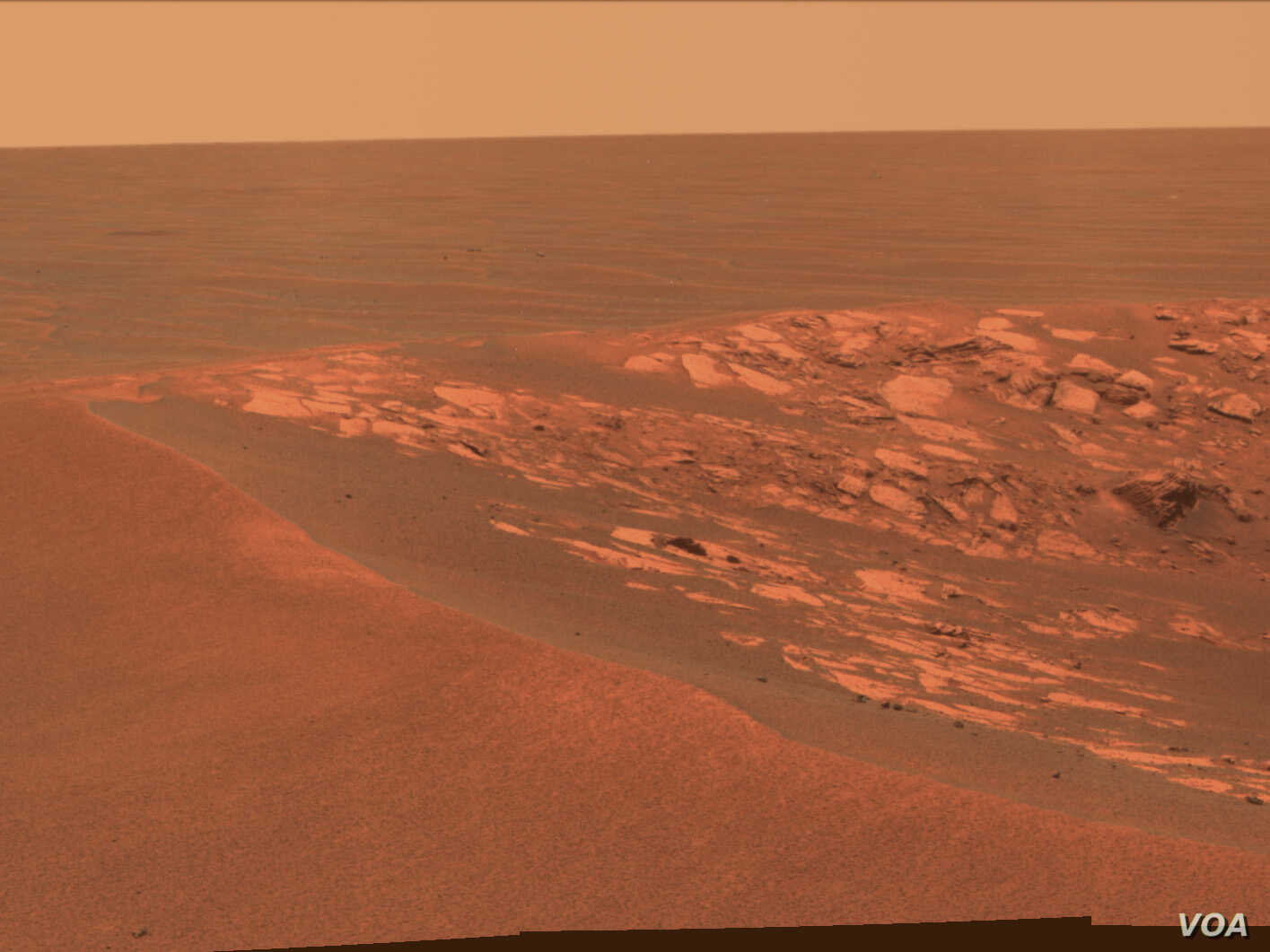"A view of the surface of Mars taken at the ""Intrepid"" crater by the Opportunity Mars Rover on November 11, 2010. (NASA/JPL-Caltech/Cornell University)"