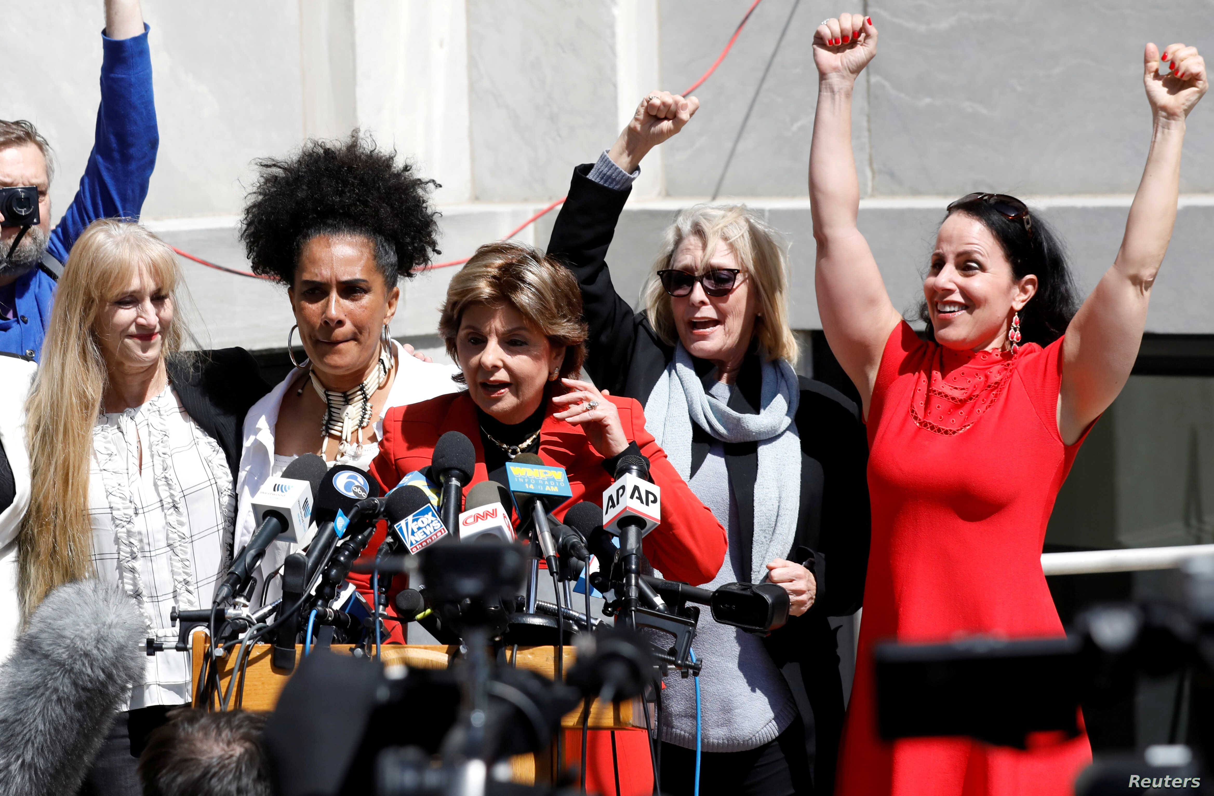 Attorney Gloria Allred stands with accusers of actor and comedian Bill Cosby after a jury convicted him in a sexual assault retrial at the Montgomery County Courthouse in Norristown, Pennsylvania, April 26, 2018.