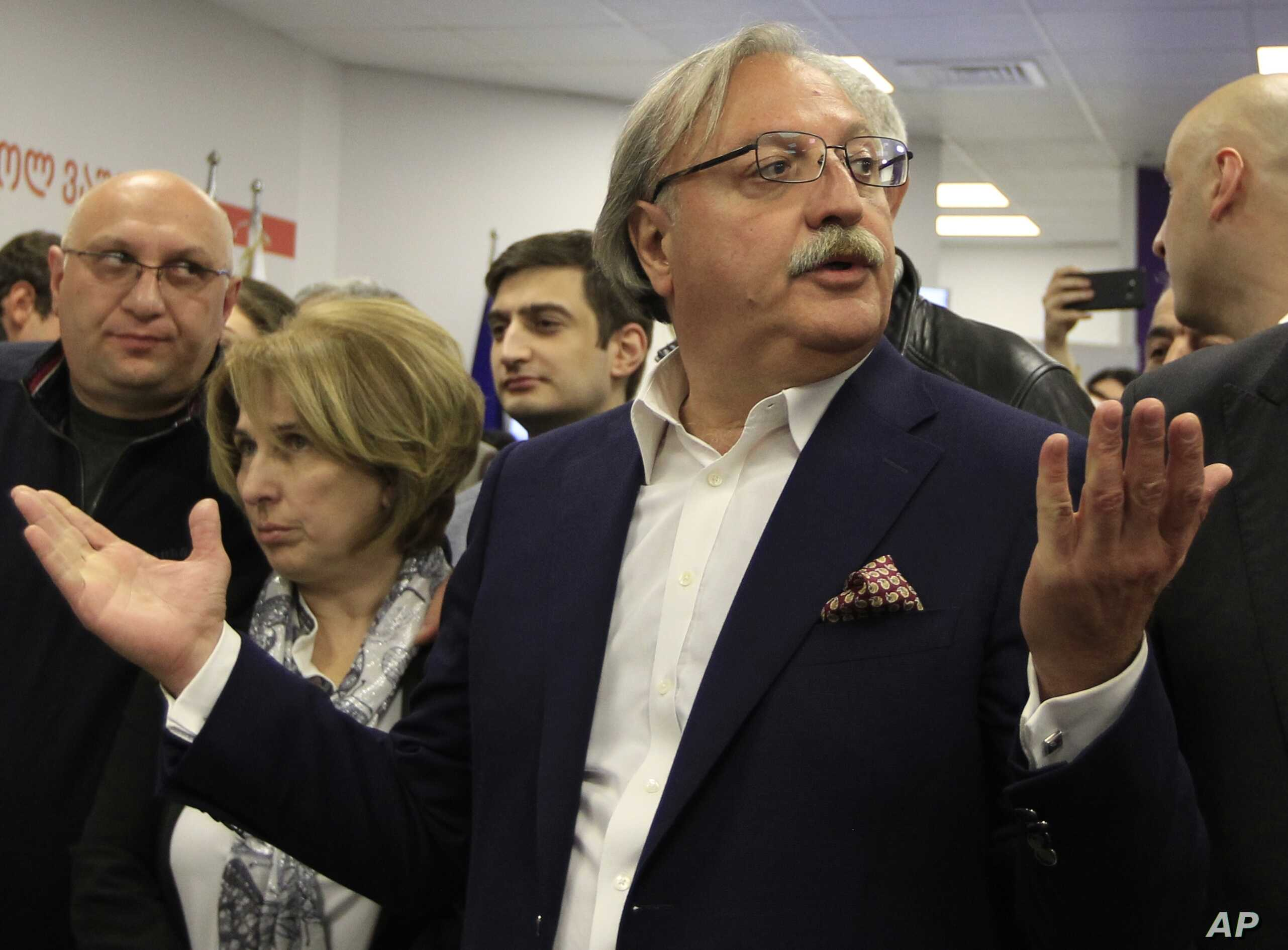 Grigol Vashadze, Georgia's former foreign minister and presidential candidate, center, gestures while speaking to journalists at his headquarters during the presidential election in Tbilisi, Georgia, Oct. 28, 2018.