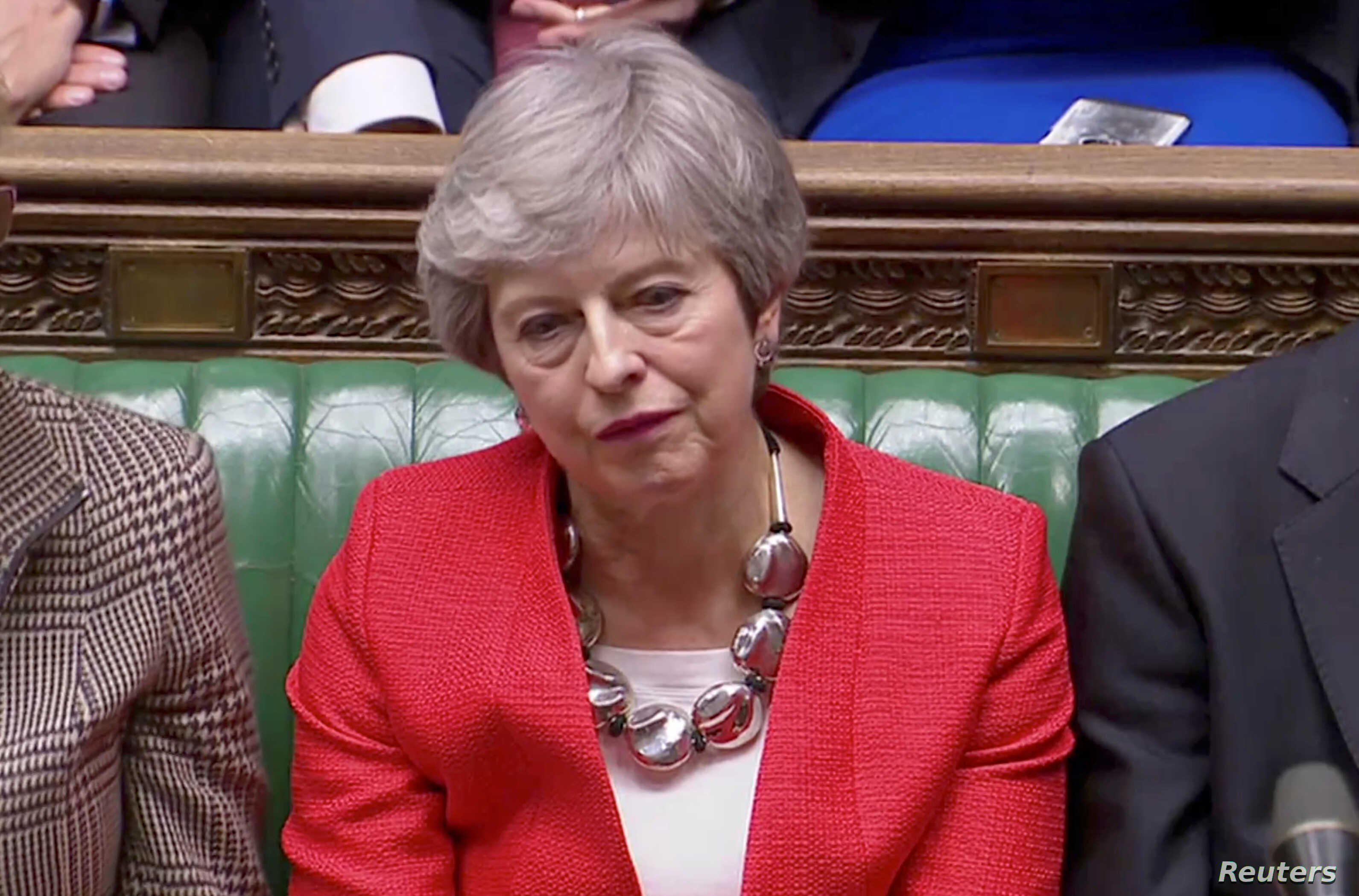 British Prime Minister Theresa May reacts after tellers announced the results of the vote Brexit deal in Parliament in London, Britain, March 12, 2019, in this screen grab taken from video.